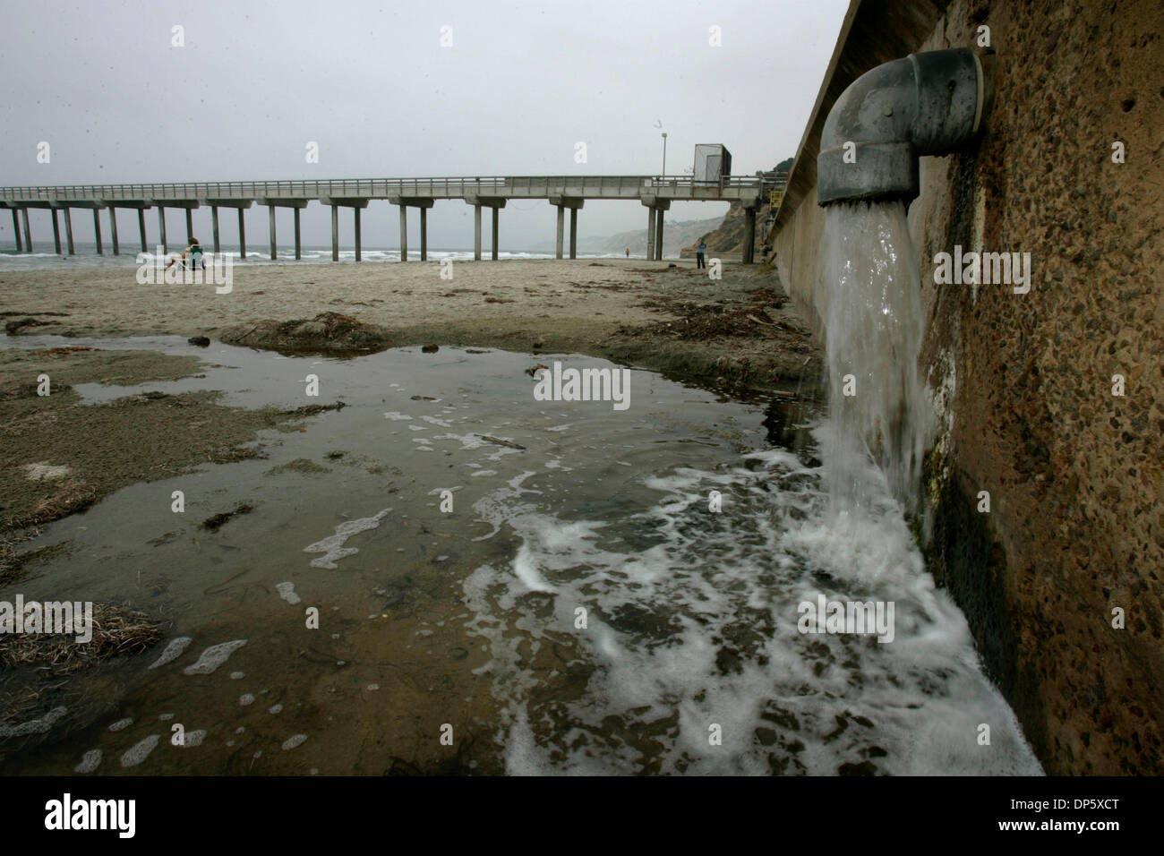 Sep 27, 2006; San Diego, CA, USA; One of six salt-water outflow pipes, sorth of the pier at Scripps Institute of Oceanography in La Jolla. The pipes discharge varying amounts of salt-water that is used by the Birch Aquarium at Scripps and for research at the institution, onto a strip of beach, which the state has designated an 'Area of Special Biological Significance'. Mandatory Cr - Stock Image