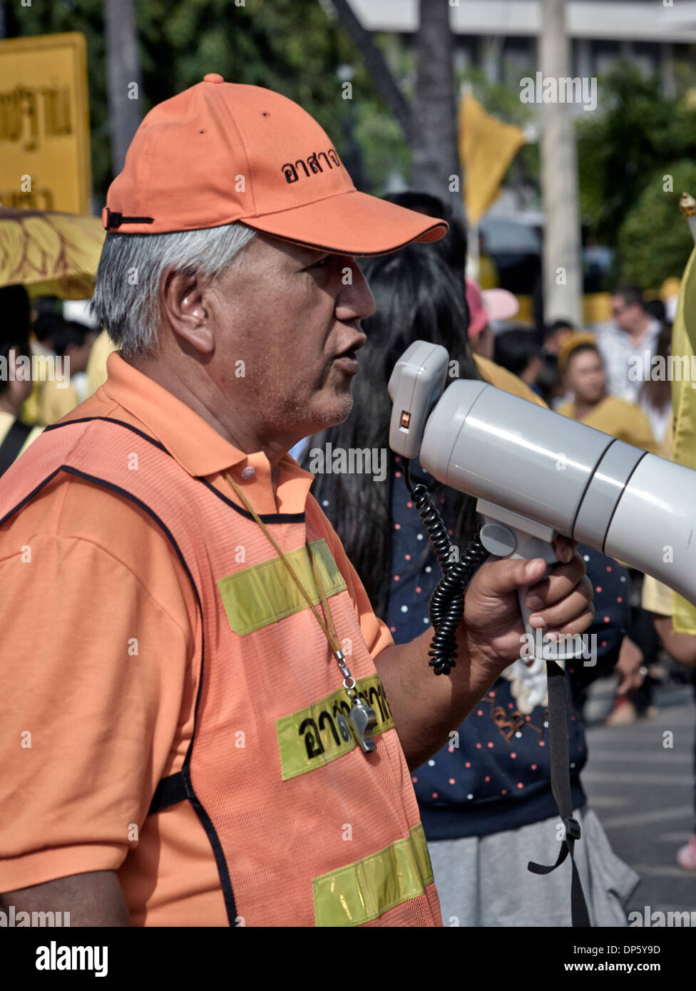 Man using a bullhorn to address a crowd - Stock Image