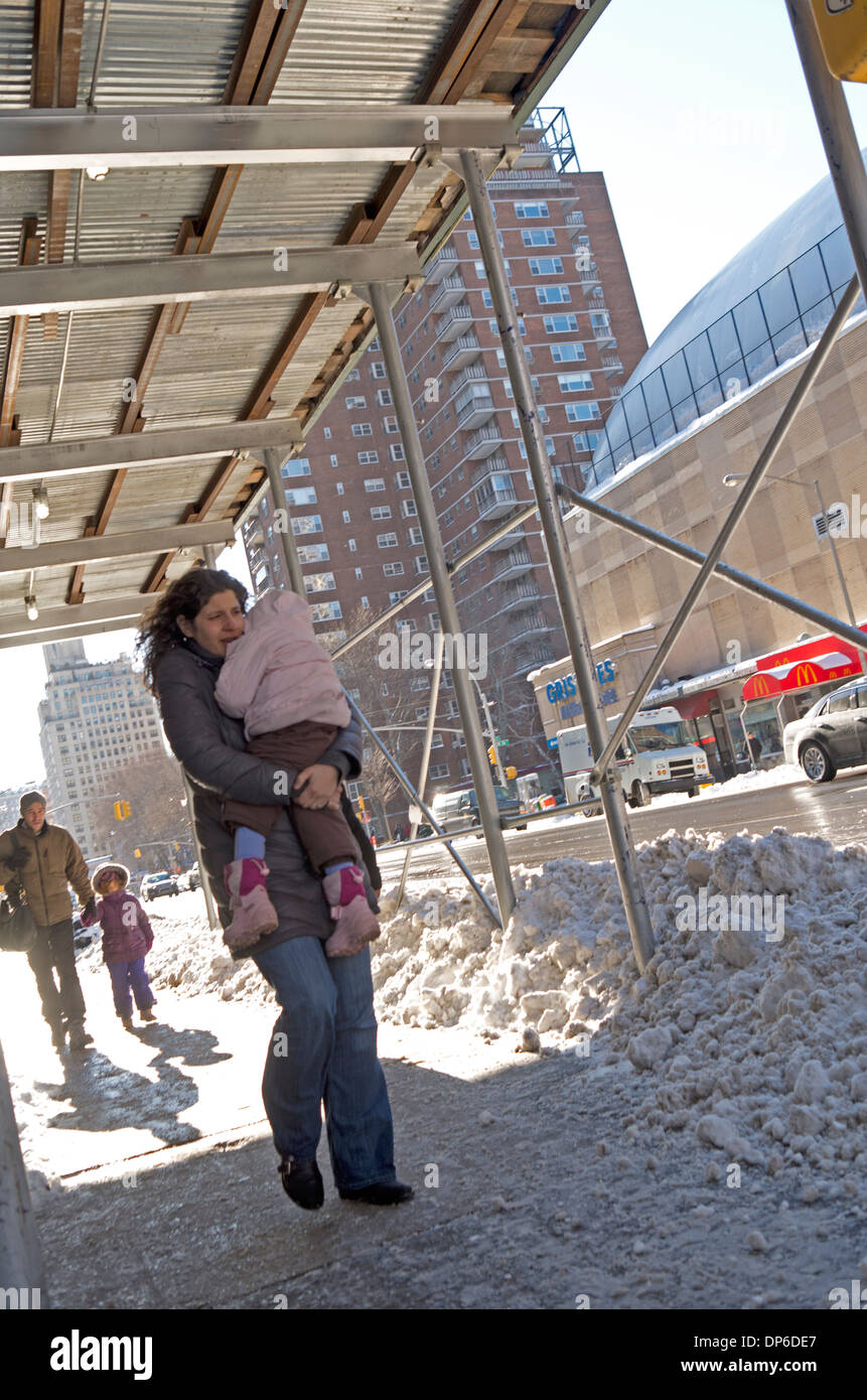 Family out in New York after the snowfall in January 2014 - Stock Image