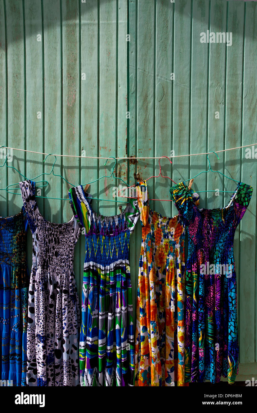 Dresses for sale along Jolly Beach resort and spa, Bolans Village, Antigua, Leeward Islands, West Indies - Stock Image