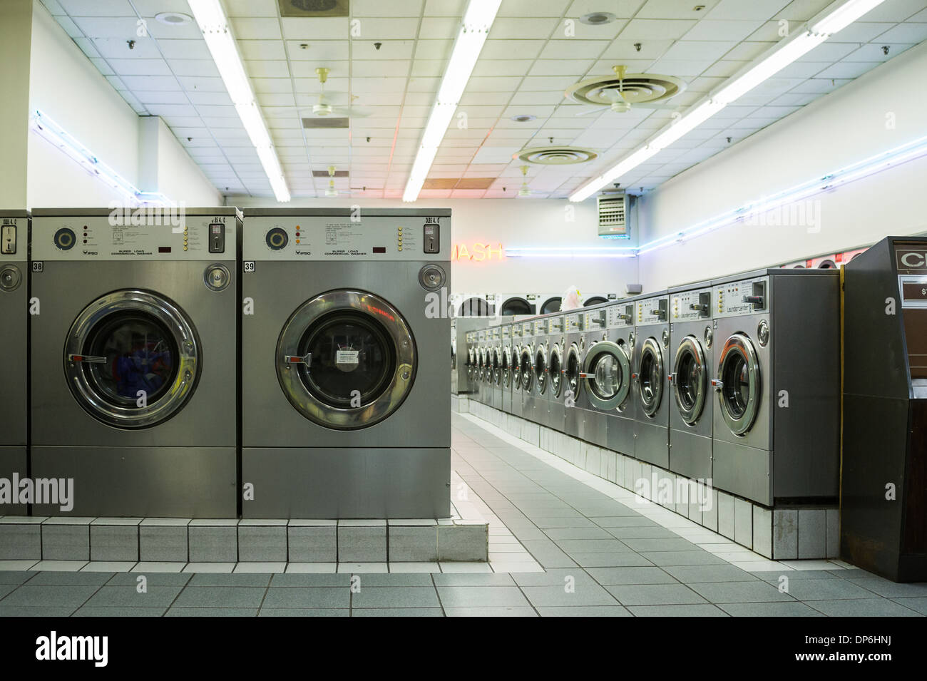 Laundromats are a quintessential part of any big City landscape: an indispensible element to many city dwellers' lives - Stock Image