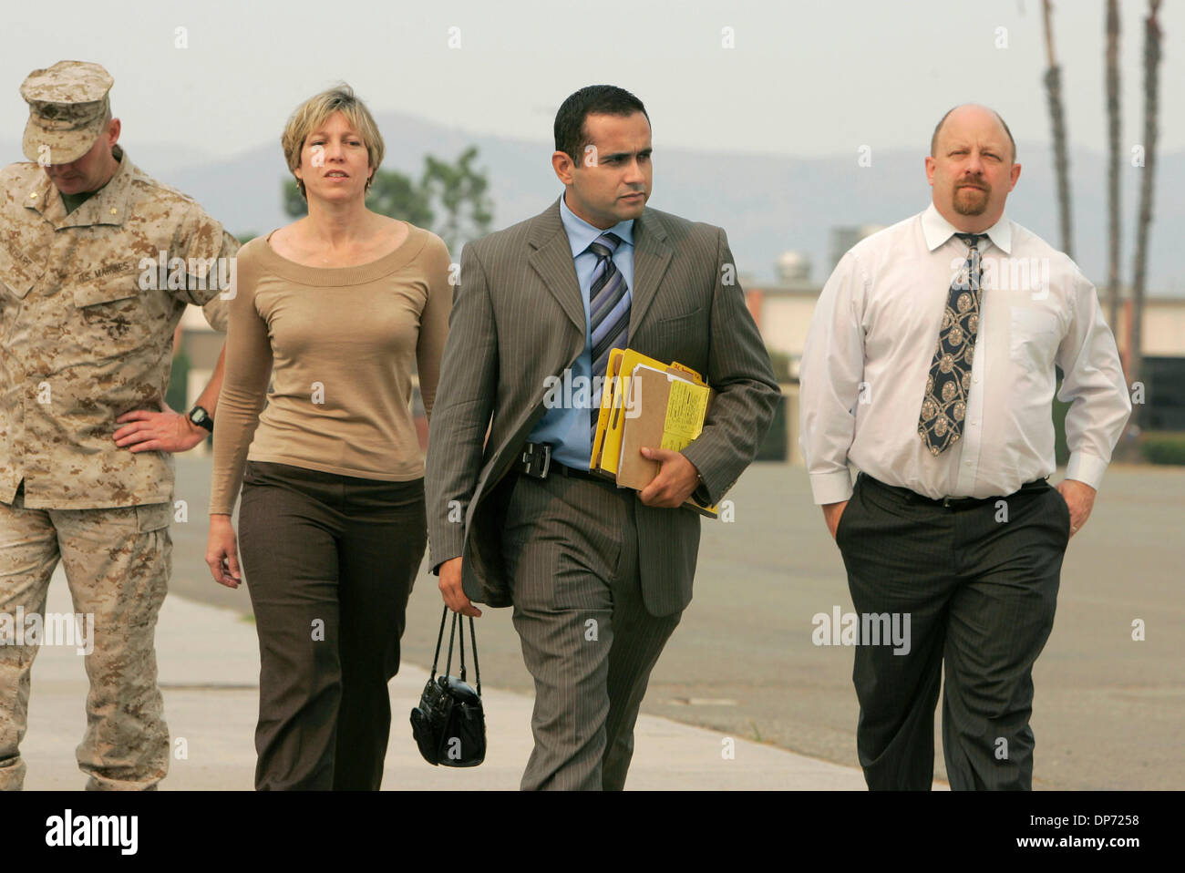 Oct 26, 2006; Camp Pendleton, CA, USA; After PFC John Jodka's court-martial his parents CAROLYN and JOHN JODKA walk with their son's civilian lawyer JOSEPH CASAS (dark coat), far right, to meet with the press. Marine at far left is Major JEFF NYHART of the base's Public Affairs office. Mandatory Credit: Photo by Charlie Neuman/SDU-T/ZUMA Press. (©) Copyright 2006 by SDU-T - Stock Image