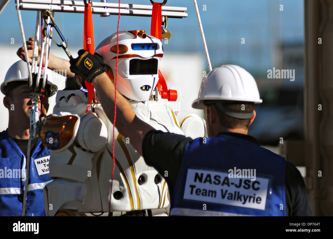 Technicians prepare the Valkyrie Humanoid Robot during the DARPA Rescue Robot Showdown at Homestead Miami Speedway December 20, 2013 in Homestead, FL. The DARPA event is to challenge teams to design robots that will conduct humanitarian, disaster relief and related operations. - Stock Image
