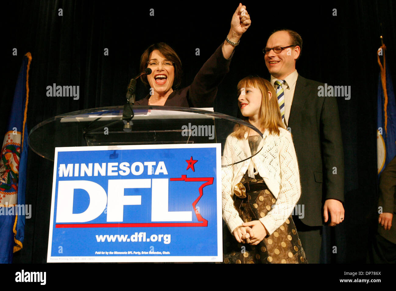 Nov 07, 2006; St. Paul, MN, USA; DFL Election Night: Amy Klobuchar raised her hand in the air as she gave a victory speech at the Crowne Plaza in St. Paul after winning the U.S. Senate race against Mark Kennedy. Beside her is her daughter and husband. Mandatory Credit: Photo by Renee Jones Schneider/Minneapolis Star Tribune/ZUMA Press. (©) Copyright 2006 by Minneapolis Star Tribune - Stock Image
