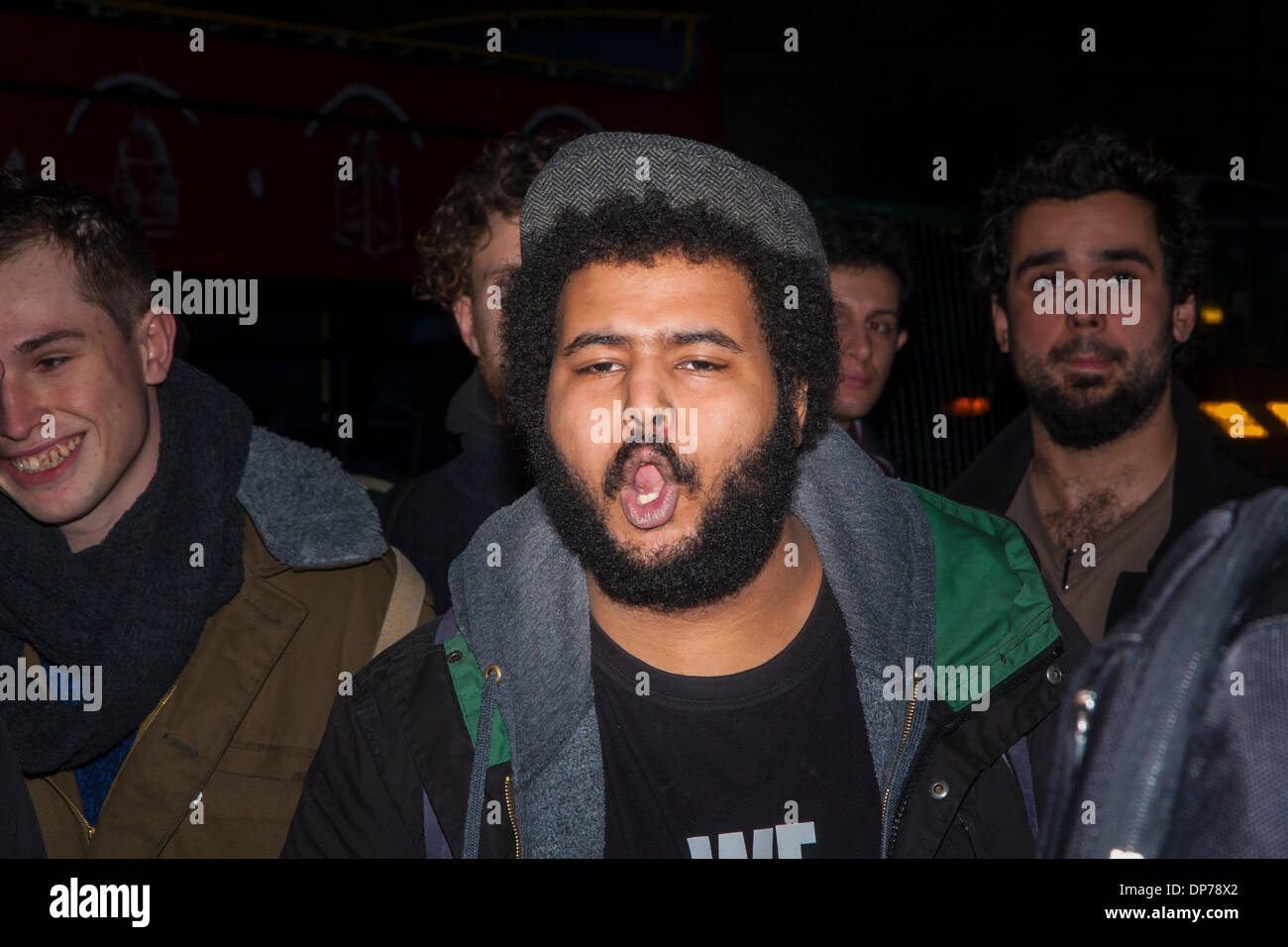 Royal Courts of Justice, London, January 8th 2014. A, angry supporter of Mark Duggan's family shouts 'No - Stock Image