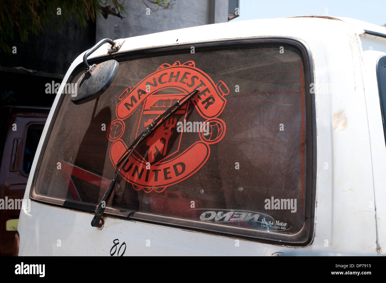 Logo for Manchester United in rear window of Matatu or Minibus in Nairobi Kenya Africa - Stock Image