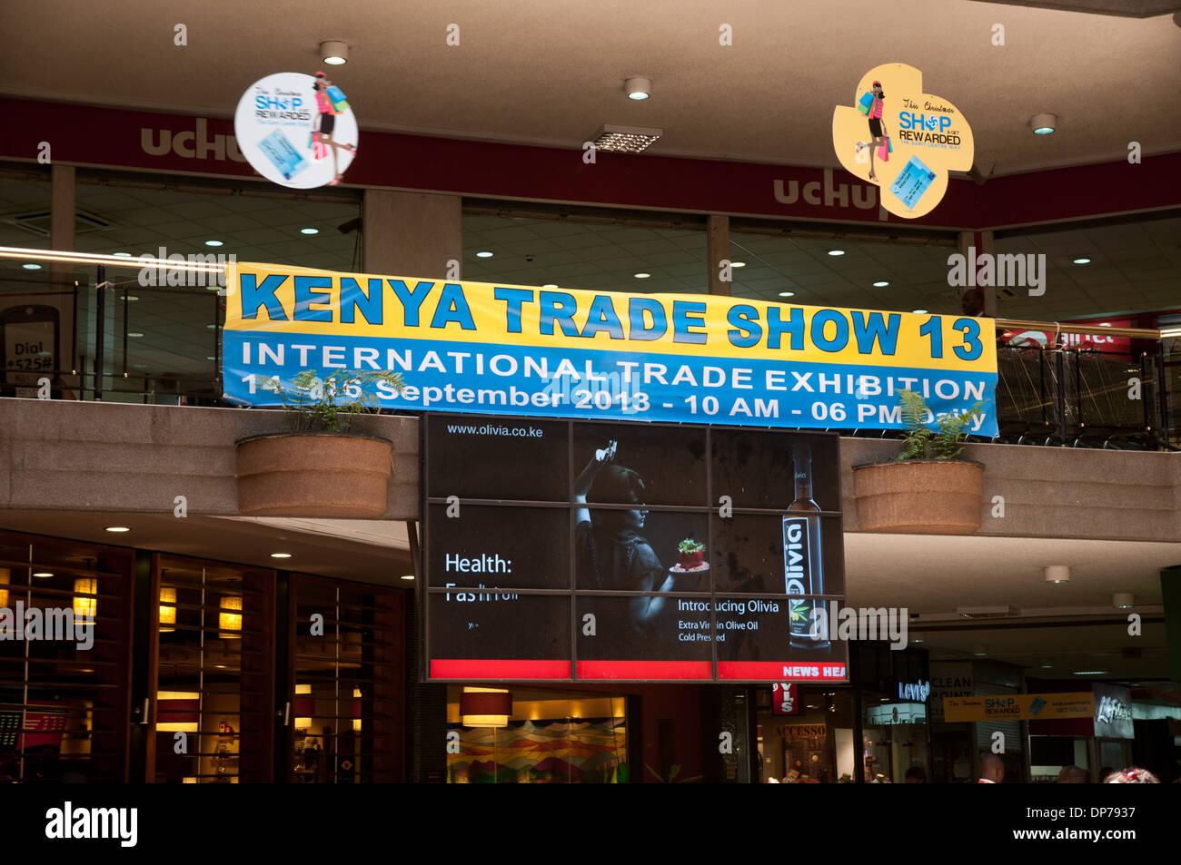 Kenya Trade Show banner on Uchumi Supermarket in the Sarit Centre Shopping Mall Westlands Nairobi Kenya - Stock Image