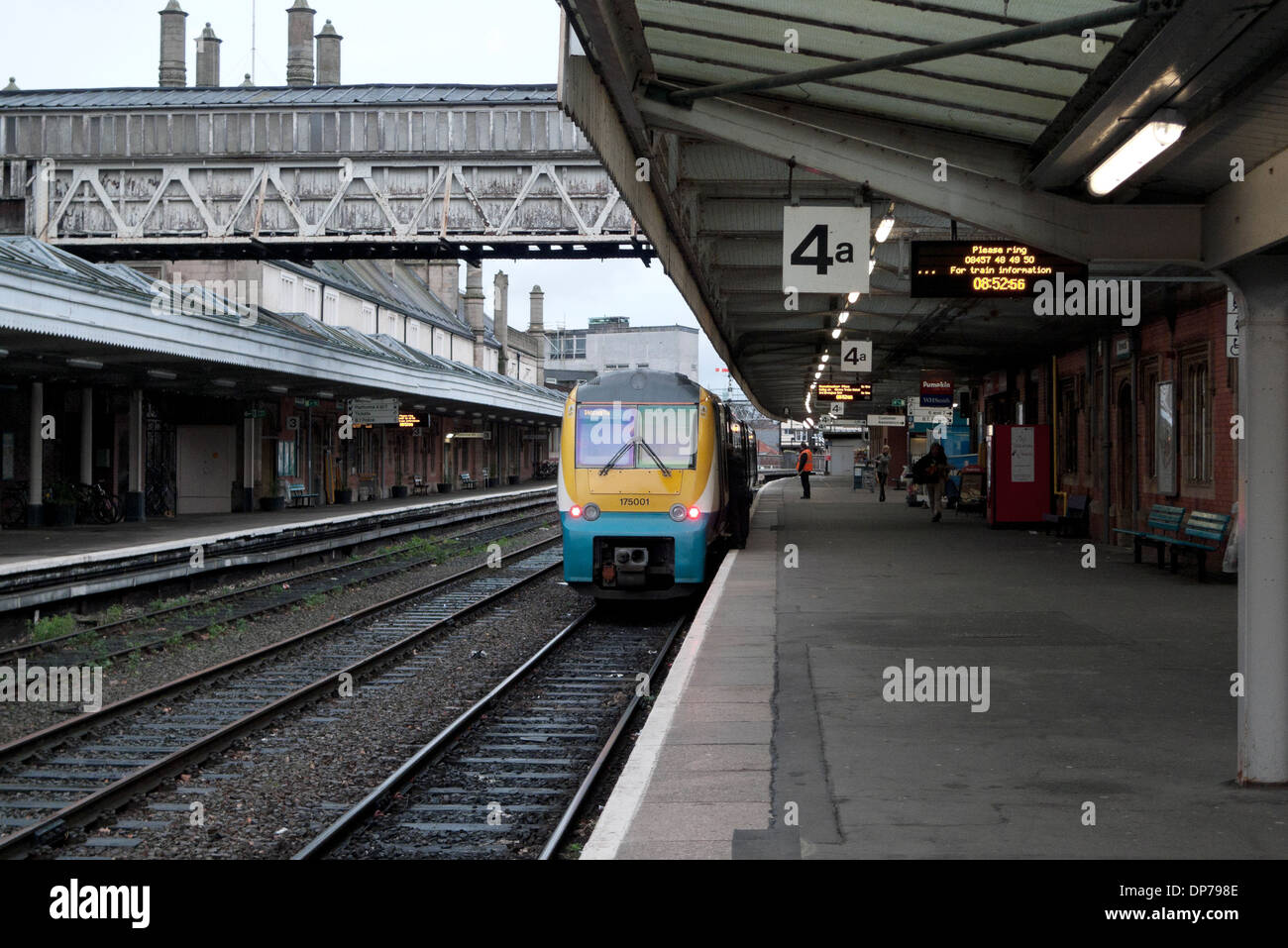 Arriva Train stopped on platform 4a at Shrewsbury Railway Station in winter with view of walking platform UK  KATHY DEWITT - Stock Image