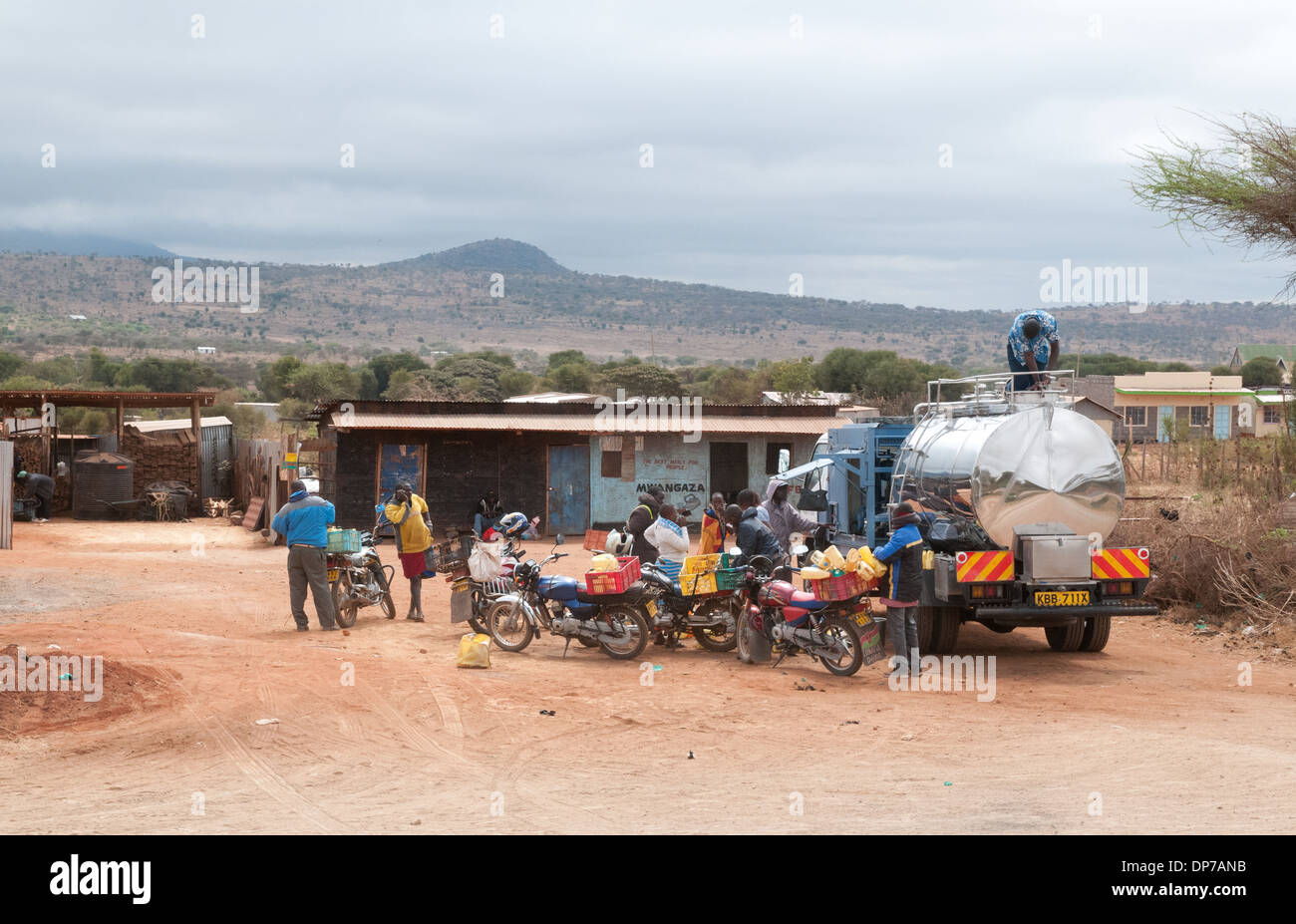 Tanker collecting milk from Motor Cyclists who bring from local people to collection point near Namanga Kenya - Stock Image