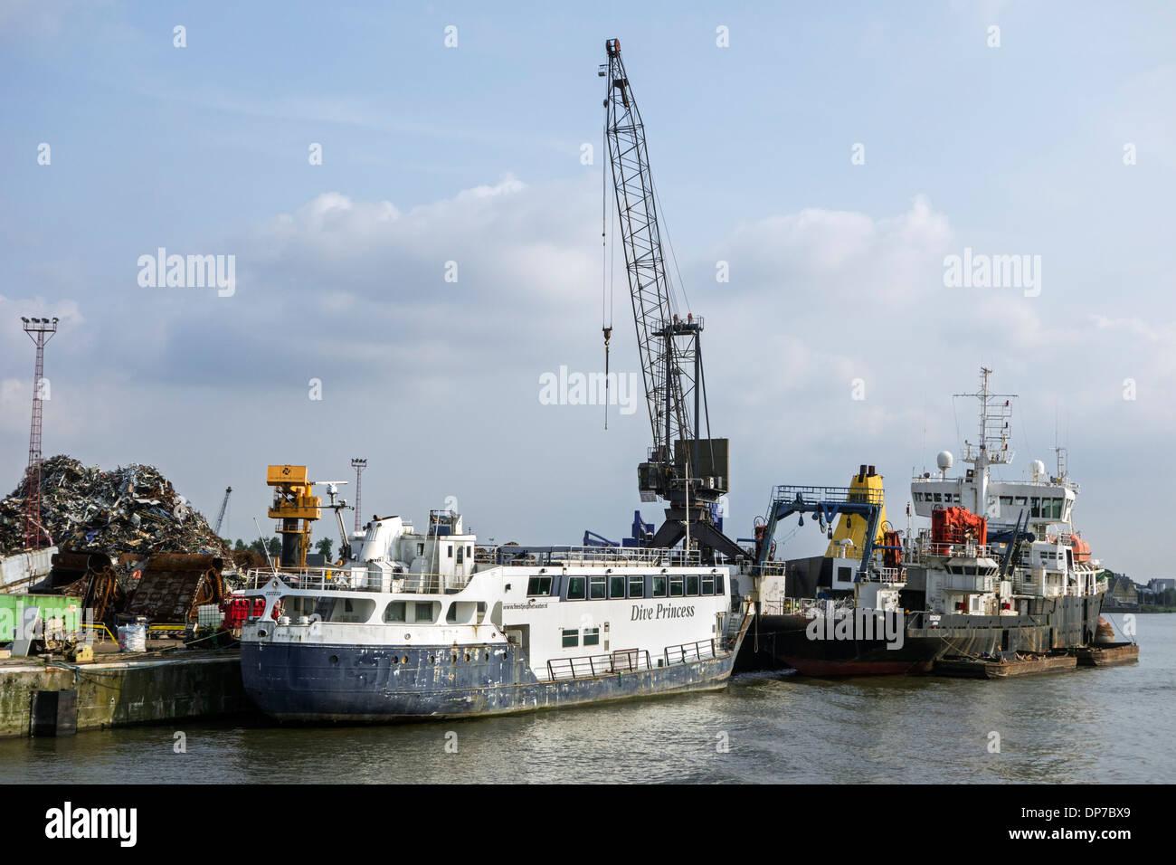 Old ship being dismantled to recycle scrap metal at Van Heyghen Recycling export terminal, port of Ghent, East Flanders, Belgium - Stock Image