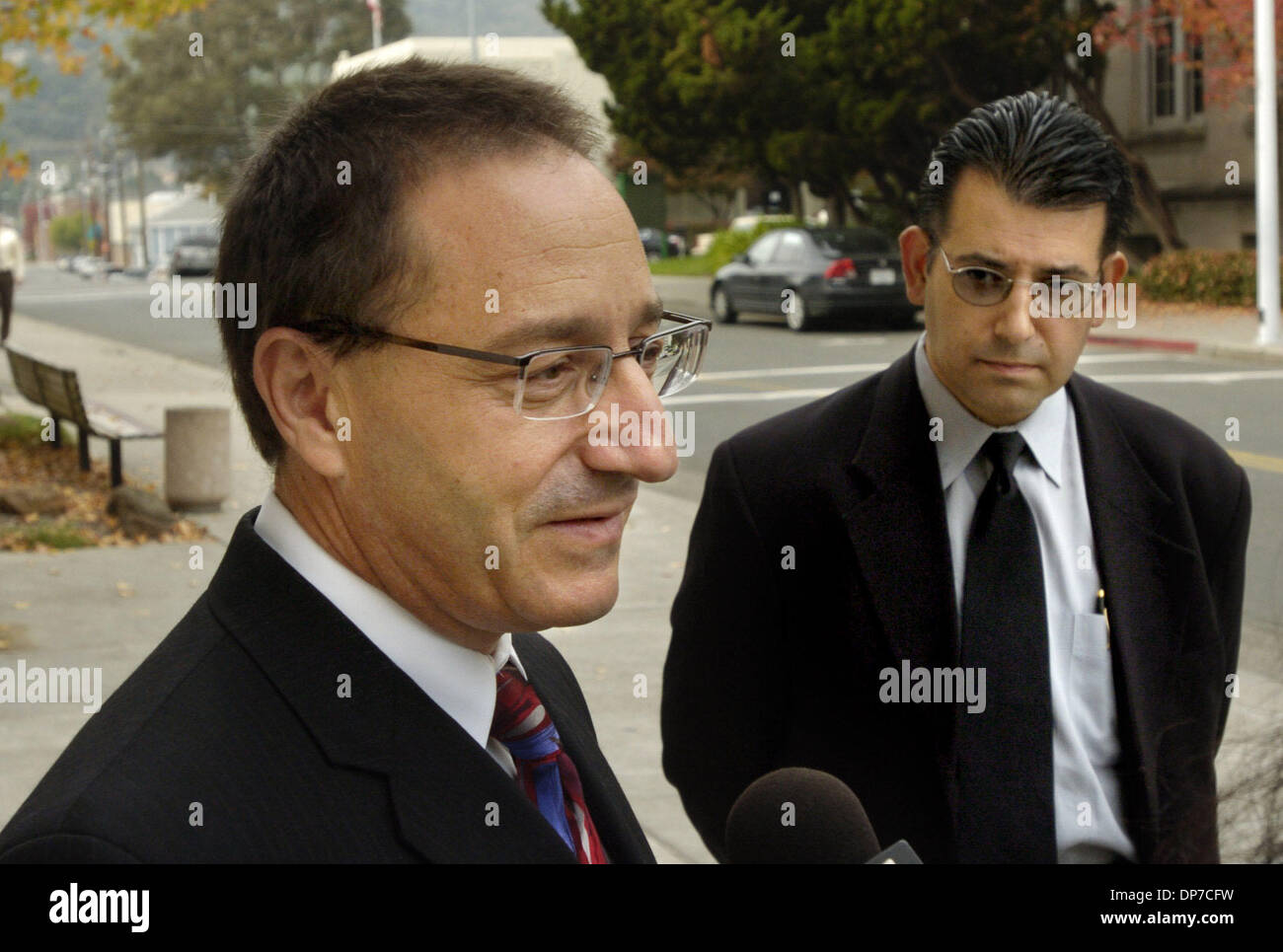 Nov 22, 2006; Martinez, CA, USA; Attorney Daniel Horowitz, left, talks about his client, Andrew Mantas, 16, not shown, outside of court in Martinez, Calif. on Wednesday  November 22, 2006.   At right is Peter Mantas, father of Andrew Mantas.  The judge had a court hearing to decide if Andrew Mantas is psychologically competent to stand trial for the killing of his mother.  Mandator - Stock Image