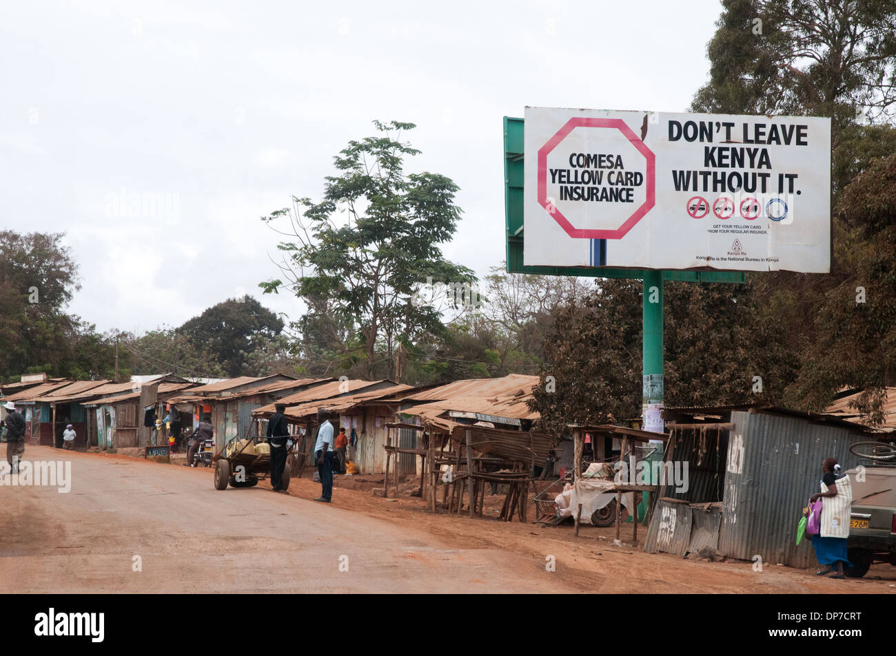 Namanga town on border between Tanzania and Kenya with low quality shops and dukas on main road to border in southern Kenya - Stock Image