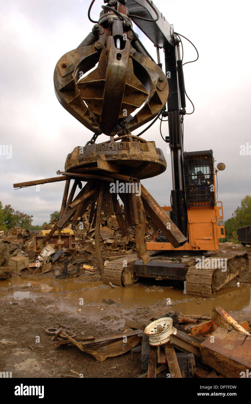 Nov 15, 2006; Atlanta, GA, USA; Scrap metal operation uses electro magnet on crane to lift iron. Some larger peices of metal are cut down with cutting torches and then flattened by huge machines, then metal is recycled by being melted down for re-use. Mandatory Credit: Photo by Robin Nelson/ZUMA Press. (©) Copyright 2006 by Robin Nelson - Stock Image