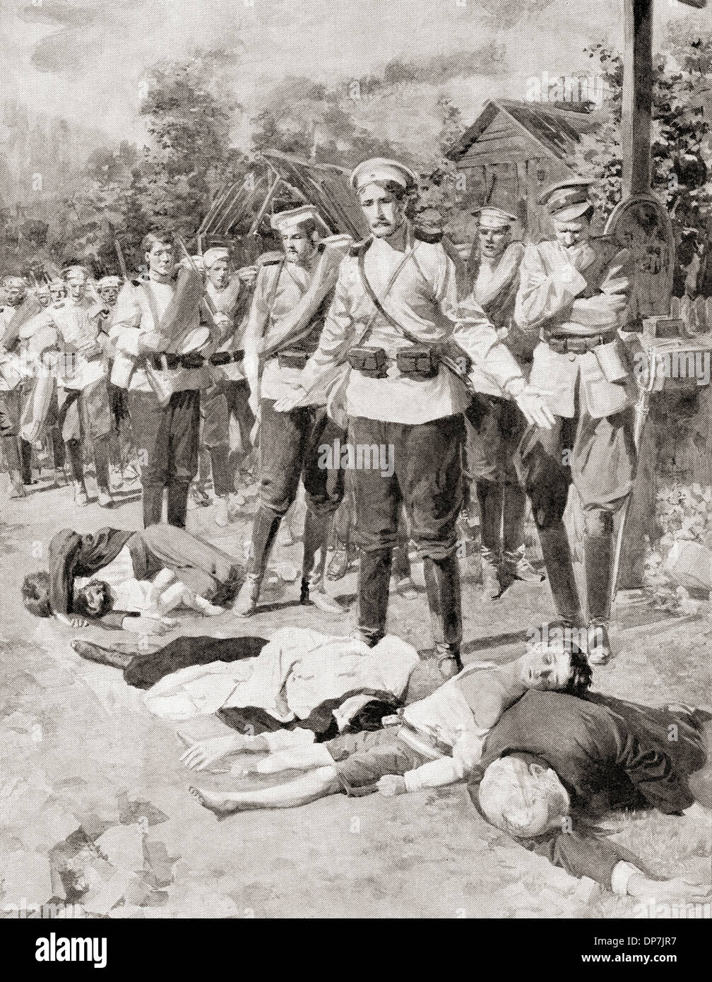 Russian soldiers look in horror at the bodies of Russian civilians killed by the Germans during WWI. - Stock Image