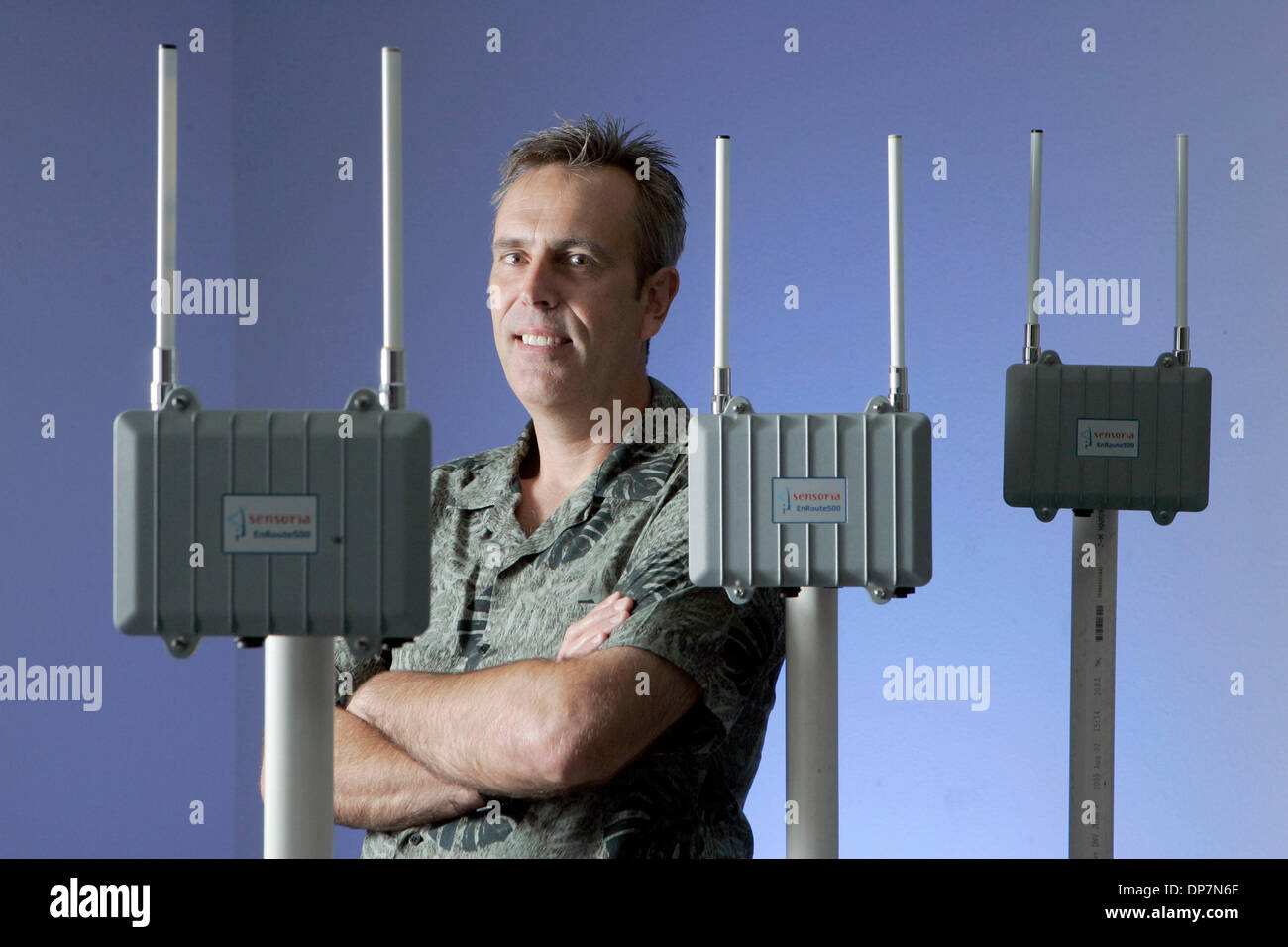 Aug 31, 2006; Rancho Bernardo, CA, USA; DAVE GELVIN is pictured with his 'EnRoute500' mesh router and WiFi access point. Gelvin is the President and CEO of Sensoria Corp. Sensoria Corp. makes wireless networks that are used not only by the military but also by universities and  municipalities that want to offer wireless, high-speed Internet access outdoors. Mandatory Credit: Photo  - Stock Image