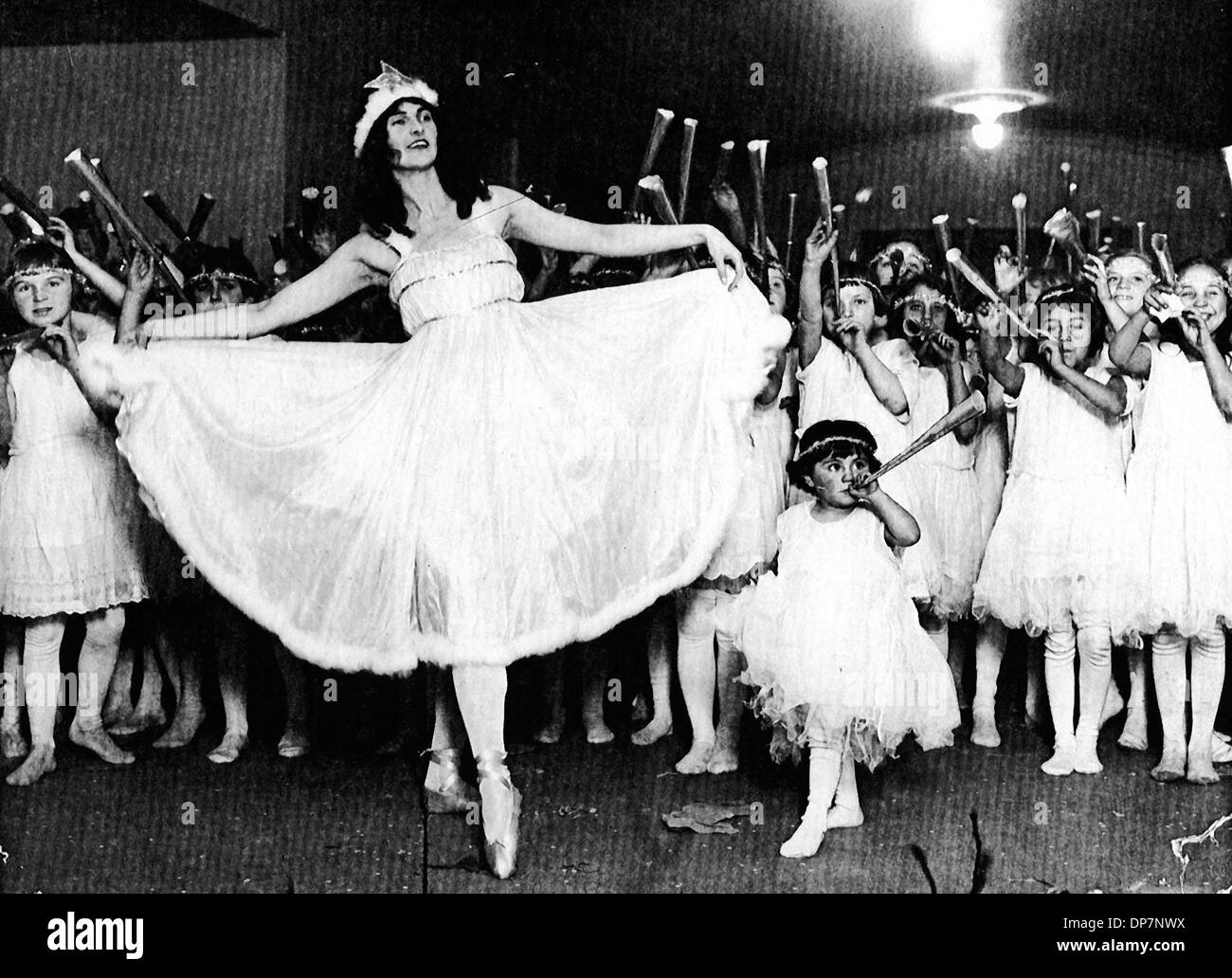 Nov 20, 2006; Oakland, CA, USA; Louise Jorgensen plays the 'Spirit of Christmas' with the 'Fairies' gathered around her during one of the first Christmas Pageants that beecame a tradition in Oakland, CA.  Mandatory Credit: Photo by Oakland Tribune/ZUMA Press. (©) Copyright 2006 by Oakland Tribune - Stock Image