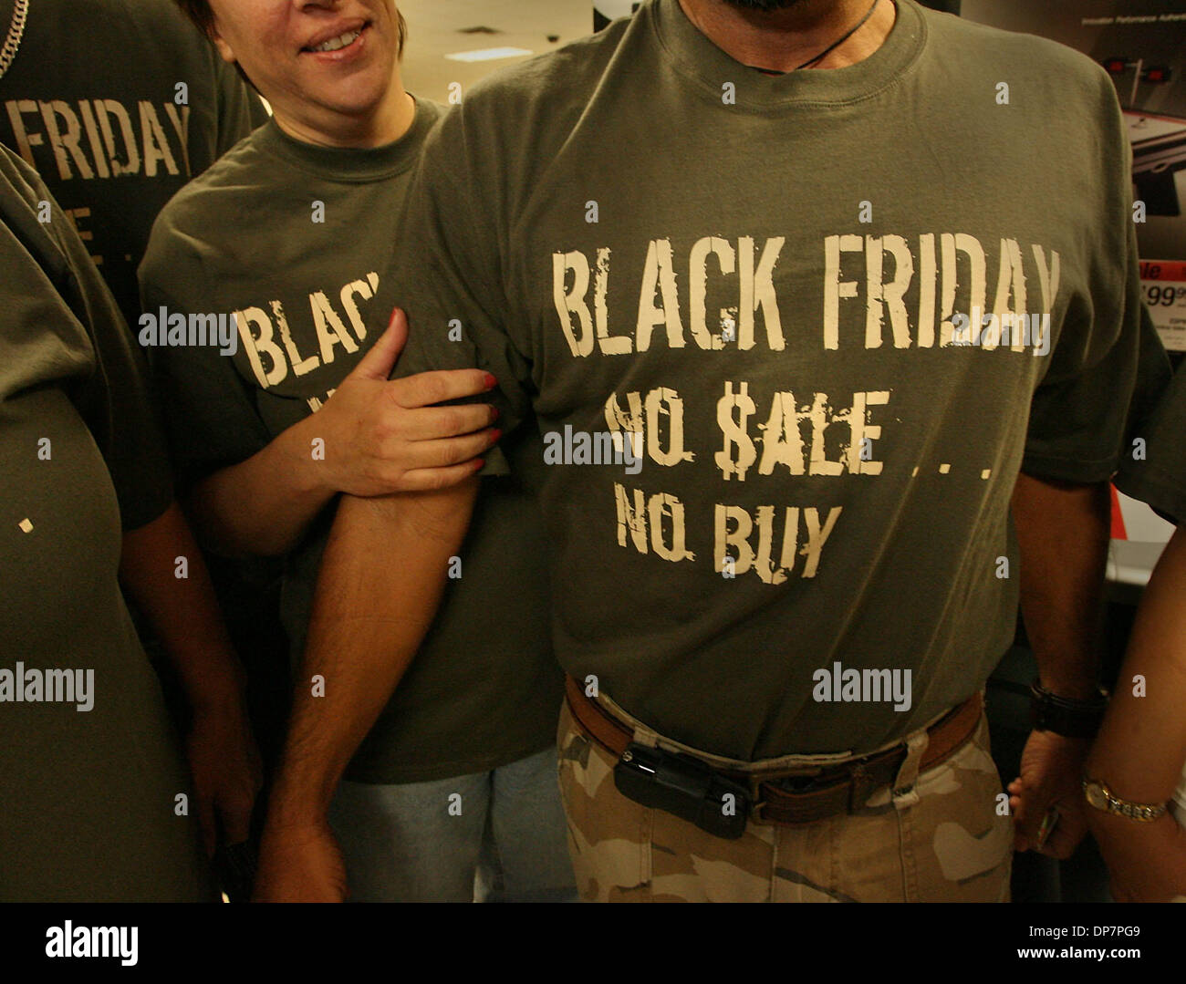 Nov 24, 2006; Boynton Beach, FL, USA; Joann and J.C. Gomez of Miami, at the Sears at the Boynton Beach Mall, just moments after the store opened at 5 a.m. They and their extended families were wearing matching t-shirts as the hit the stores at 5 a.m.  Mandatory Credit: Photo by Bob Shanley/Palm Beach Post/ZUMA Press. (©) Copyright 2006 by Palm Beach Post - Stock Image