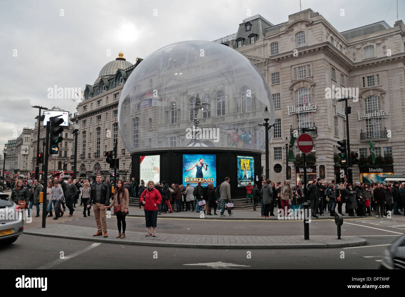 Clear plastic dome covering the statue of Anteros (it is NOT Eros) in Piccadilly Circus, London, W1, UK. - Stock Image