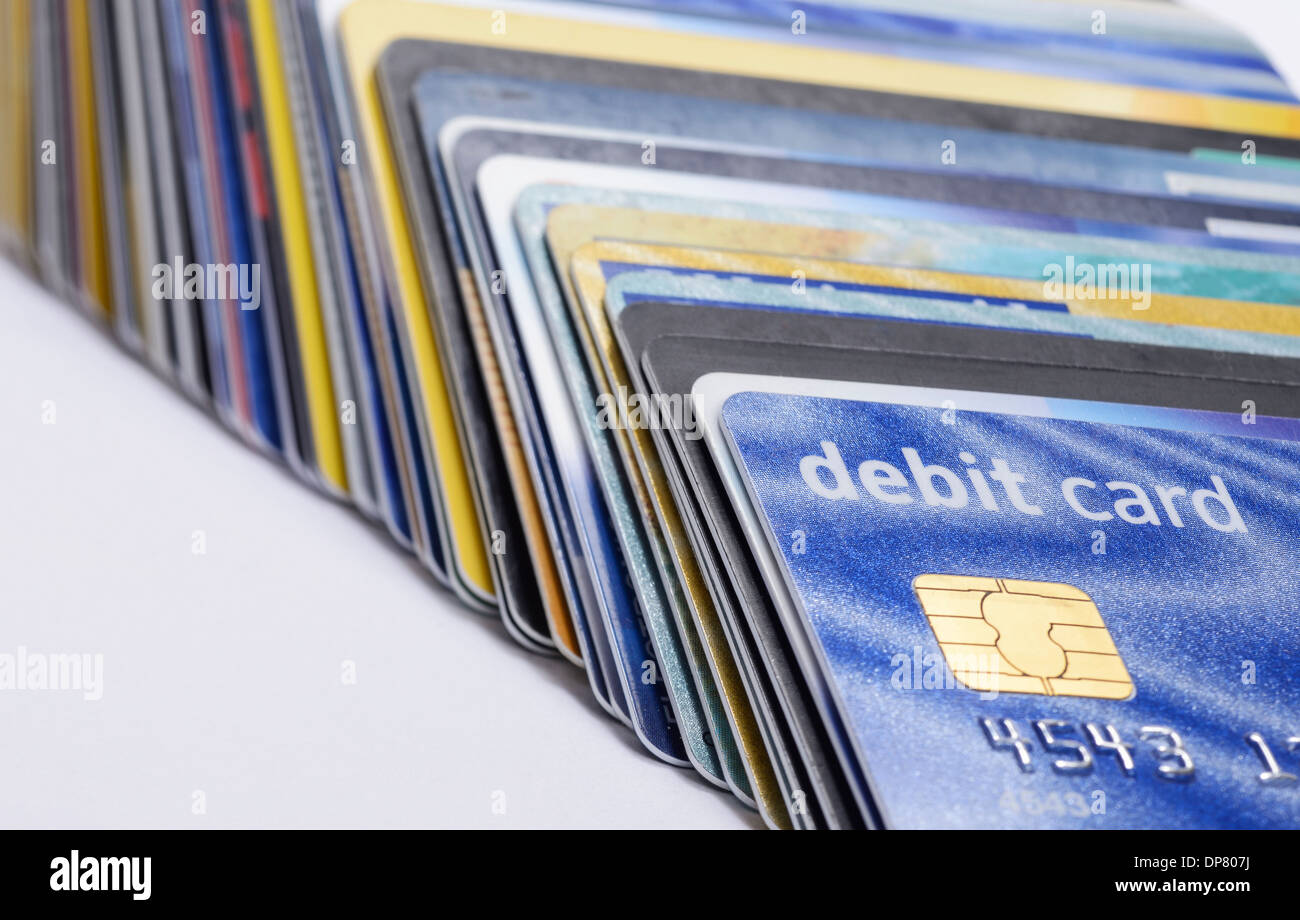Stack of plastic credit and debit chip and pin cards - Stock Image