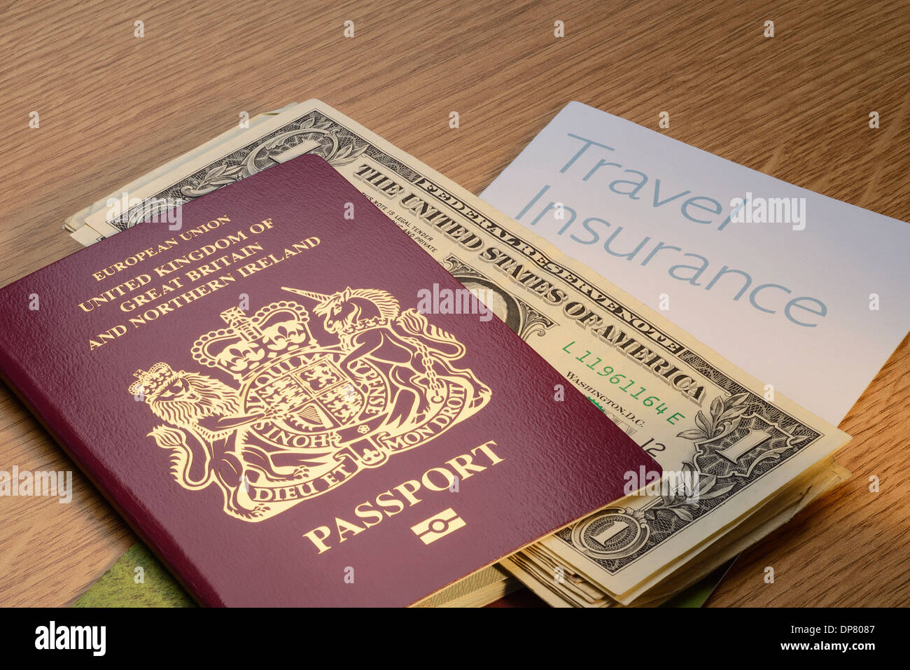 UK British passport with US Dollar money and travel insurance - Stock Image