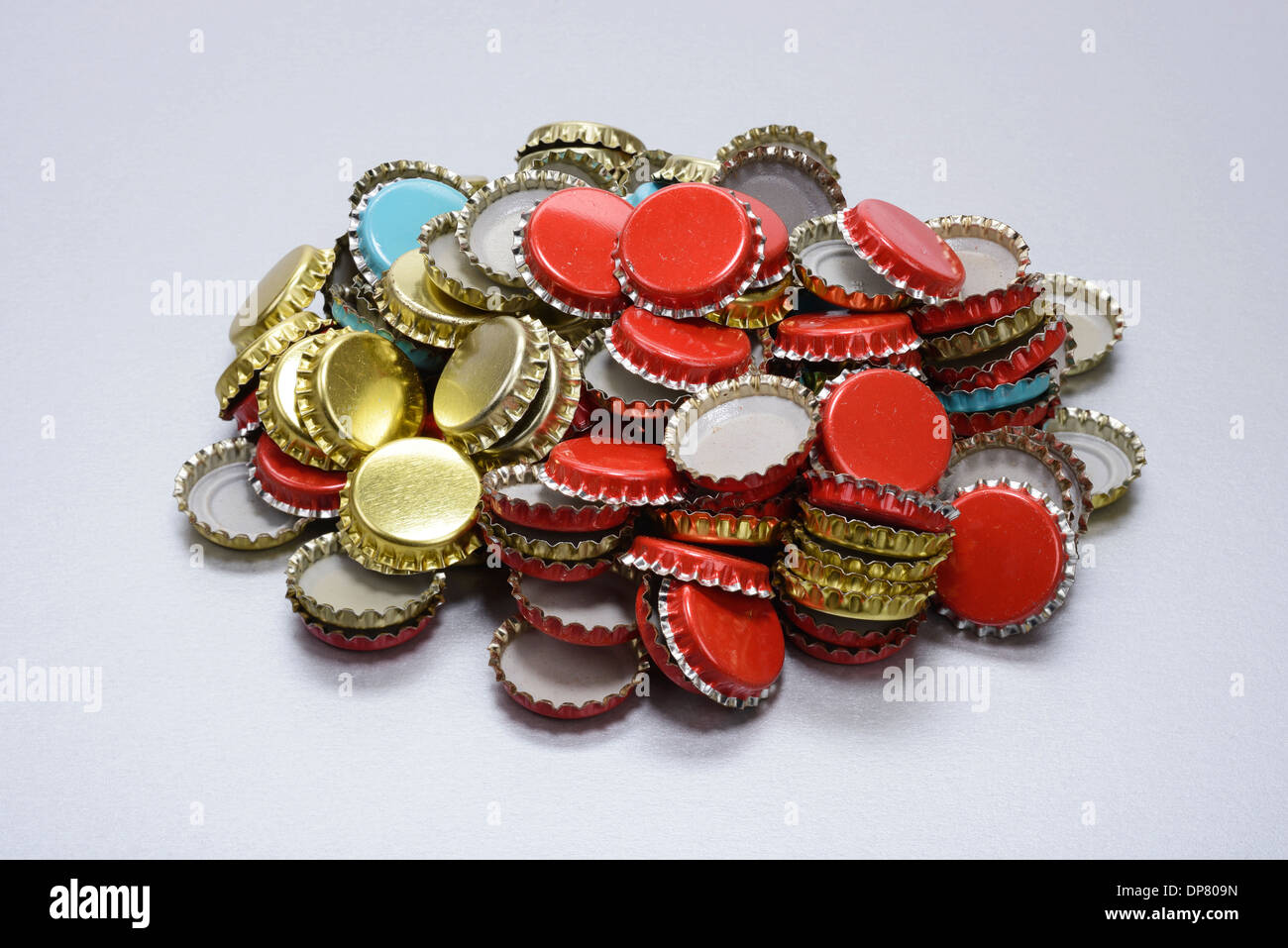 Pile of crown cork bottle caps - Stock Image