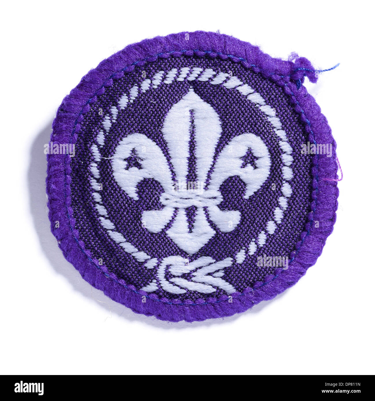Round purple Scout badge - Stock Image