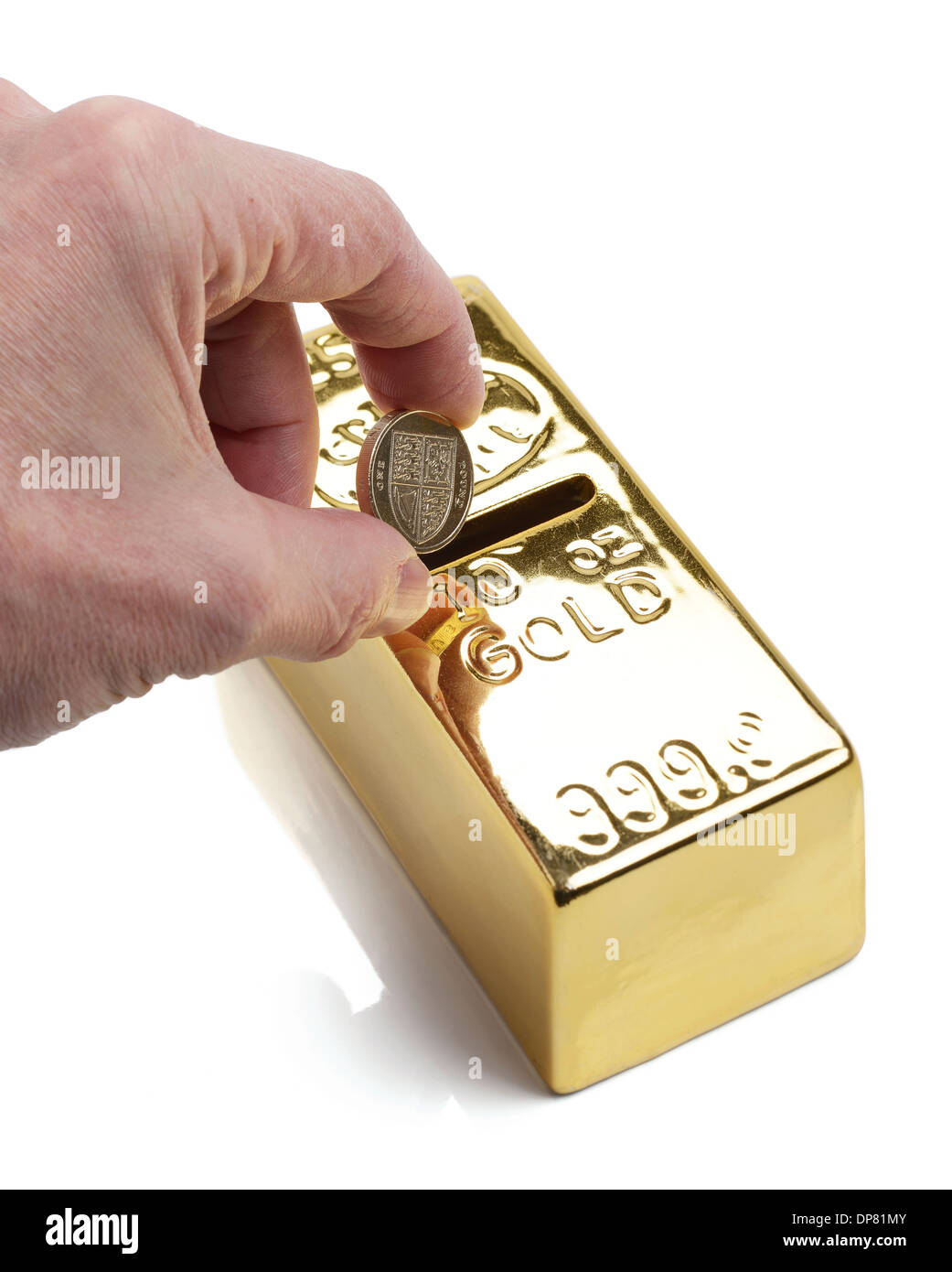 Investing money in to gold Stock Photo