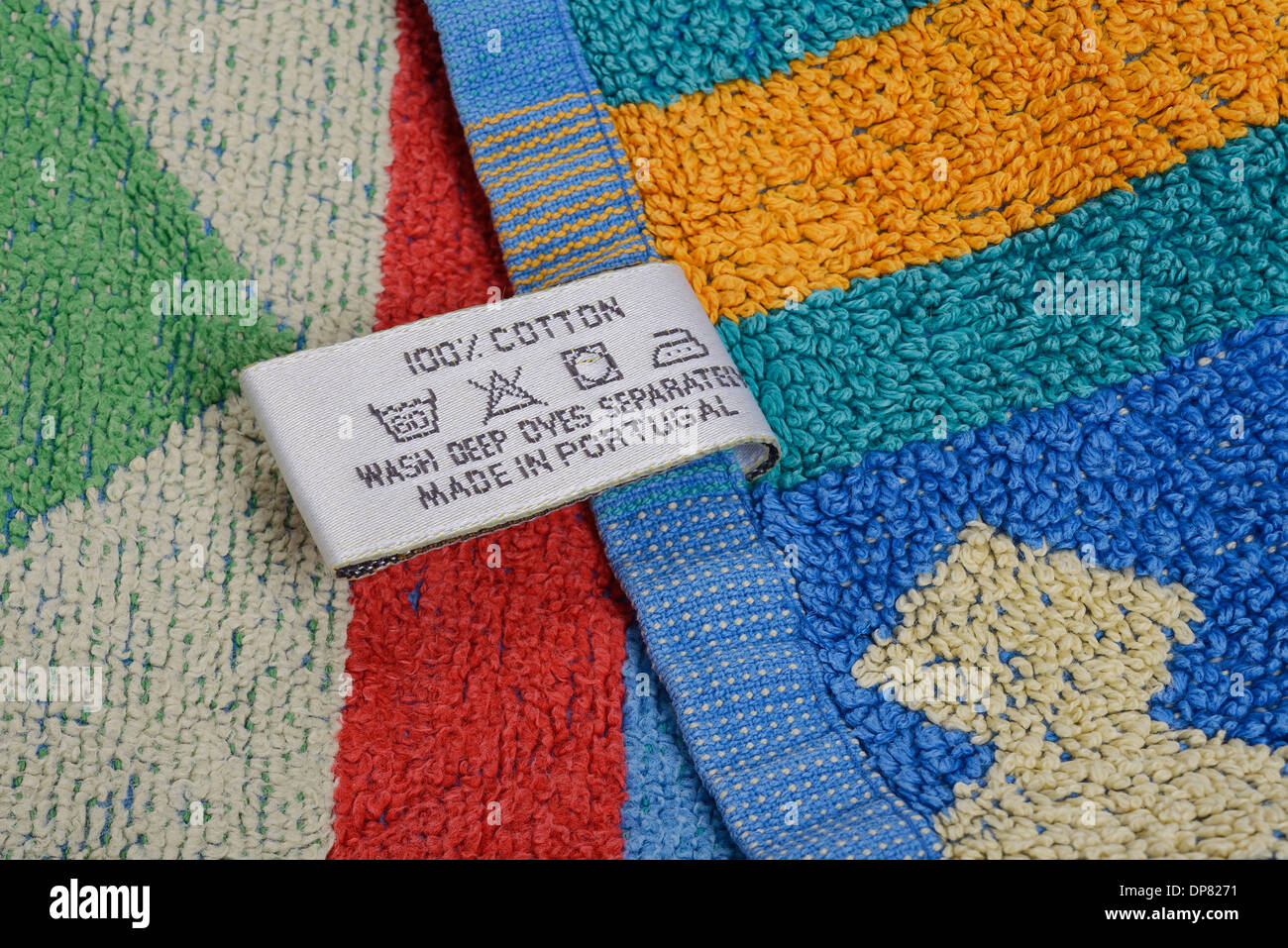 Care label on the hem of a colourful towel - Stock Image
