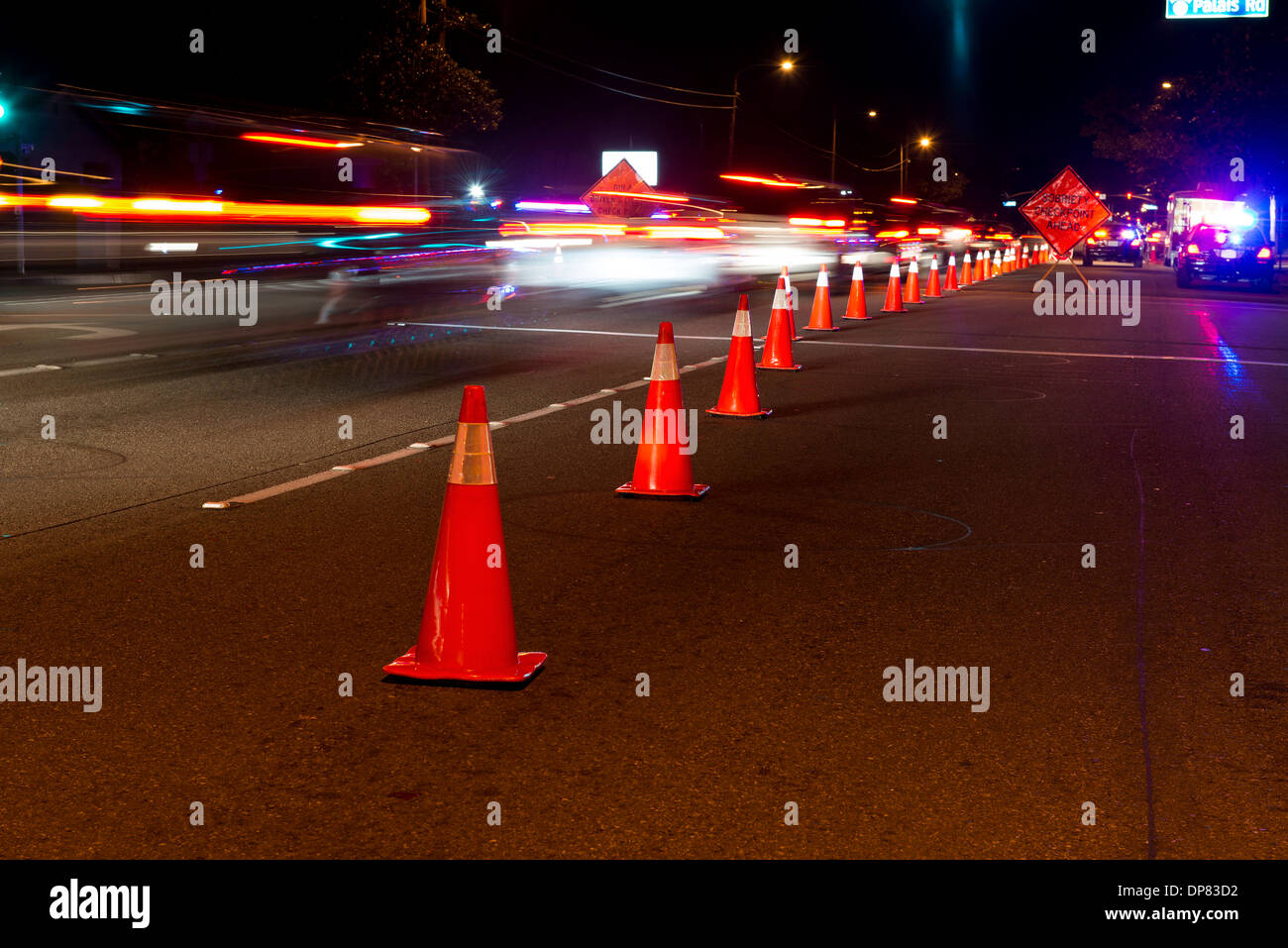Traffic cones and traffic at a DUI check point in Anaheim. - Stock Image