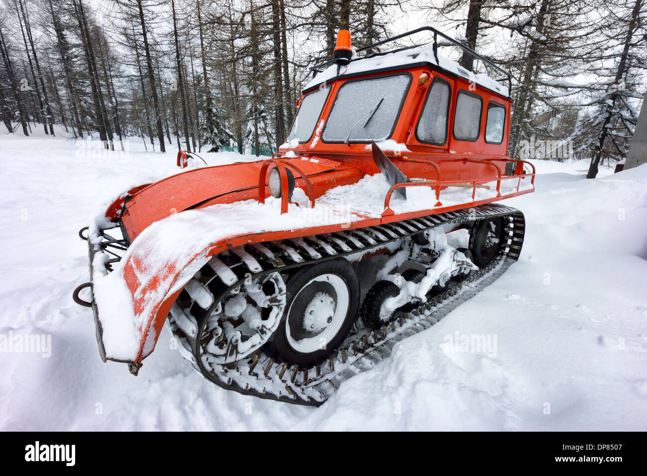 retro snow vehicle in mountain - Stock Image