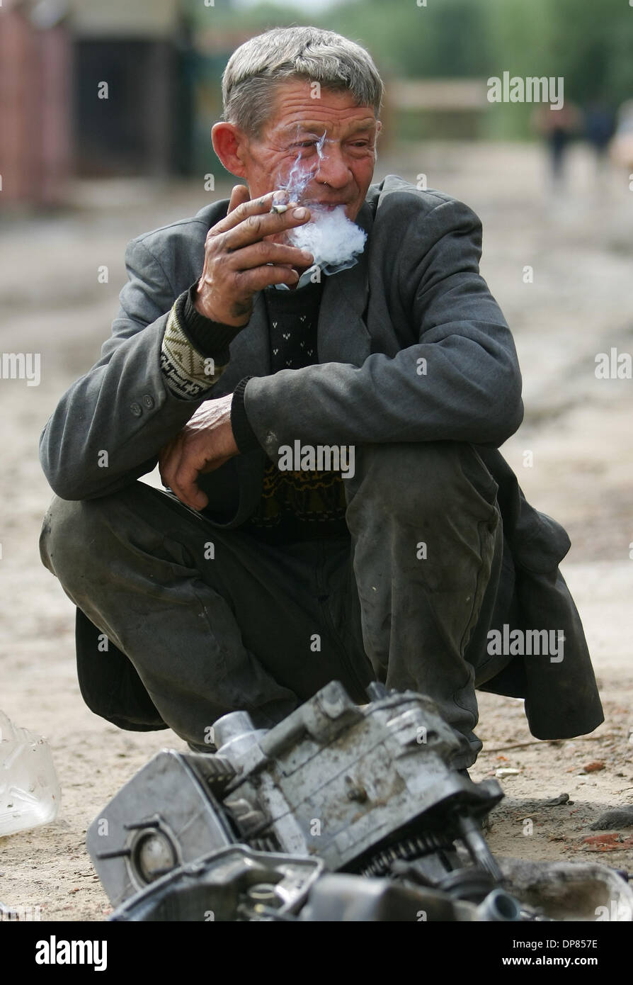 Belarus town of Gomel. Andrey is repairing his old motor cycle.People of this belarus town also suffered of Chernobyl disaster in April 1986.(Credit Image: © PhotoXpress/ZUMA Press) RESTRICTIONS: North and South America Rights ONLY! - Stock Image