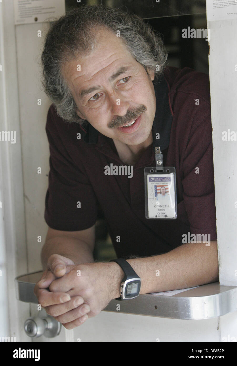 (Published 5/21/2005, B-1:2)  Newly appointed postmaster of the Delzura (Published: Dulzura)  Post Office, Kenneth Simon, talked with a customer as they approached the small post office..UT/DON KOHLBAUER - Stock Image
