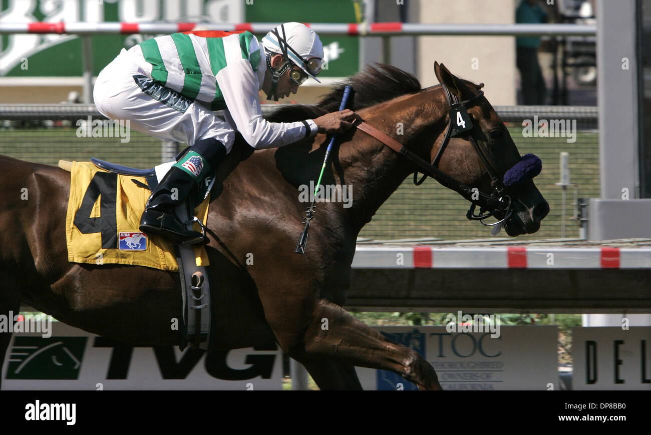 (PUBLISHED 8/21/2005, C-2) Jockey DAVID FLORES crosses the finish line, winning the 5th. race on Highest Honoree.  U/T photo CHARLIE NEUMAN - Stock Image