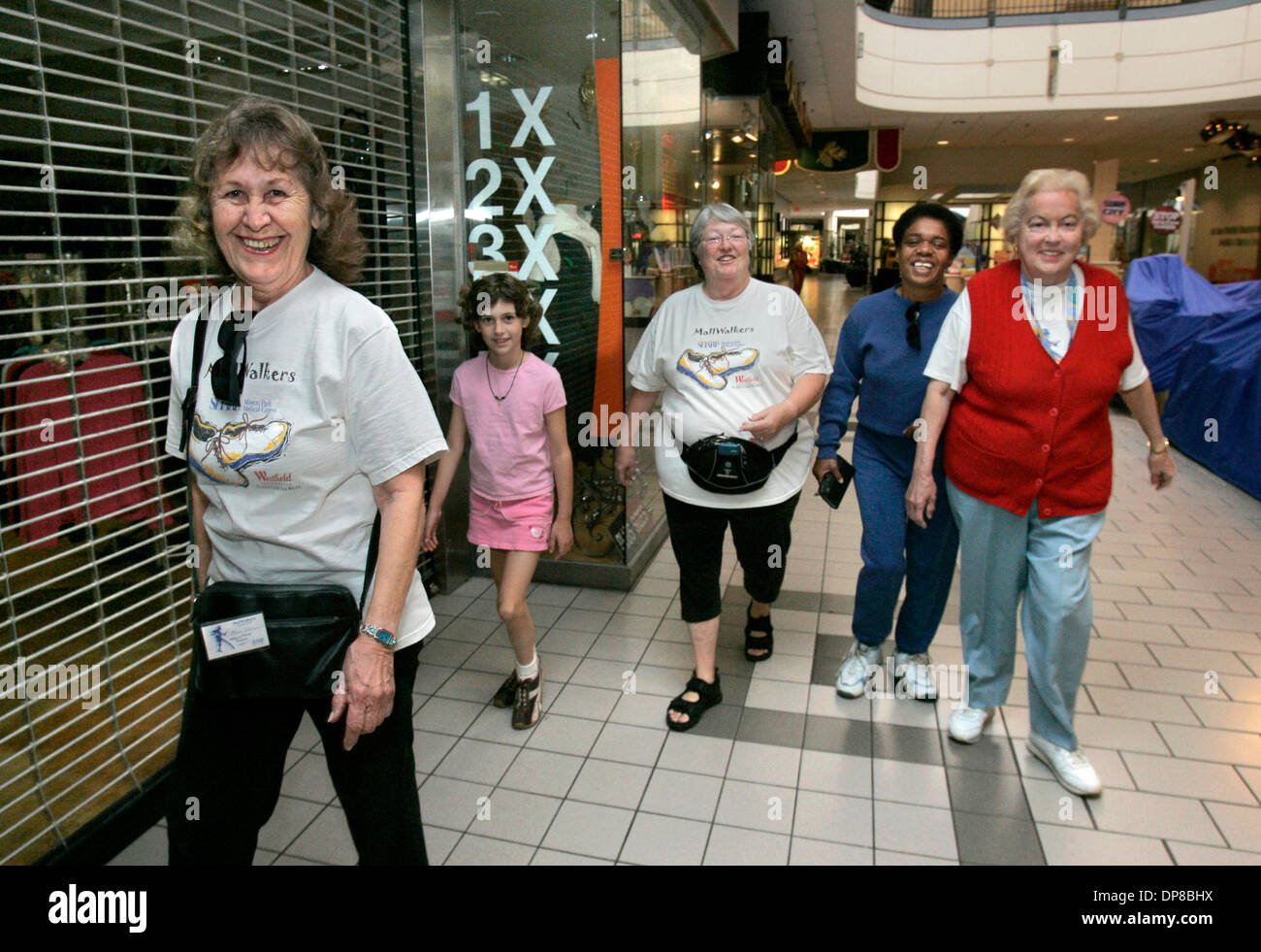 Published 12 15 2005 NC 4 A Group Of Morning Mall Walkers Make Their Way Around The Lower Level Plaza Camino Real LtoR JOAN CEDERQUIST Cq