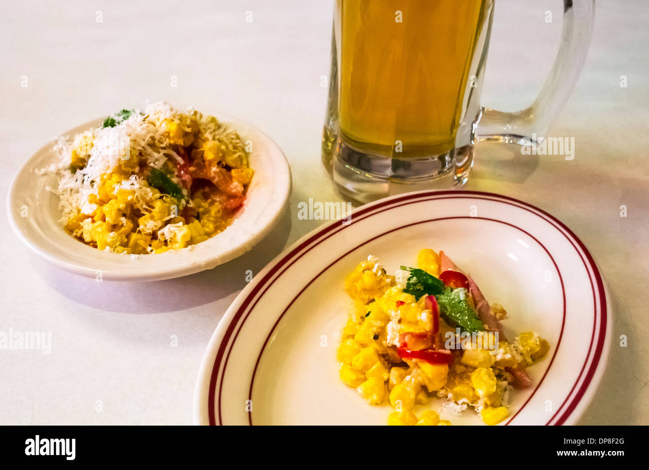 BHZ Spicy corn and peppers with cheese and a draft beer - Stock Image