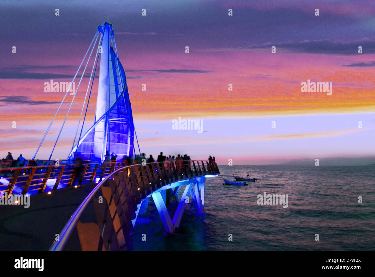 Sail sculpture illuminated at sunset, Puerto Vallarta, Jalisco, Mexico - Stock Image