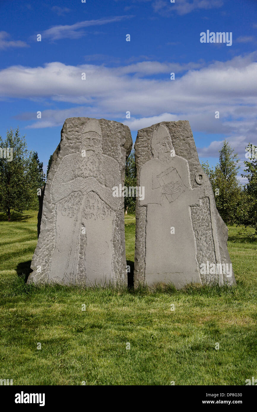 Carved stones representing paganism and Christianity, Skalholt Church, Iceland - Stock Image