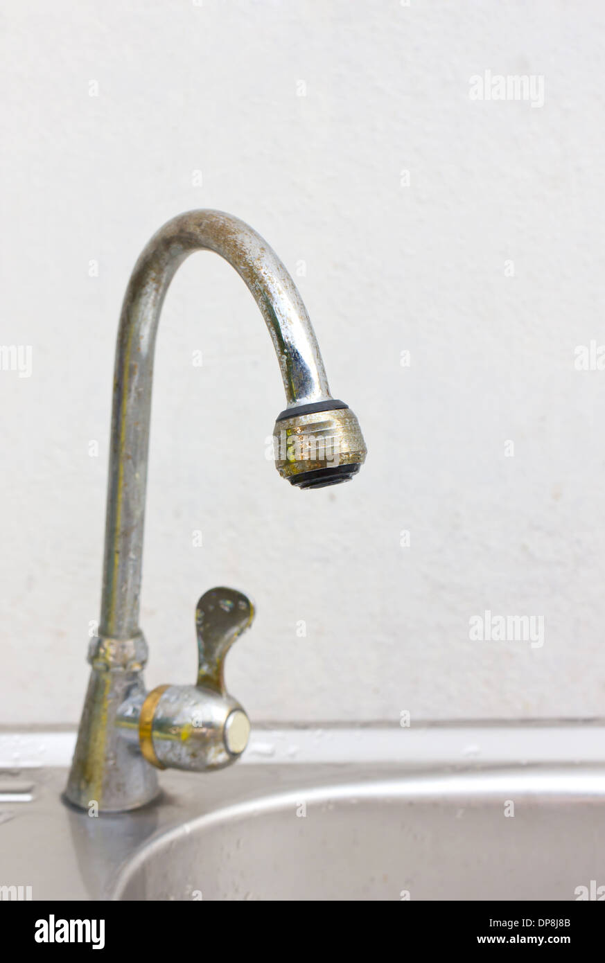 Old and dirty kitchen faucet and sink Stock Photo: 65343499 - Alamy