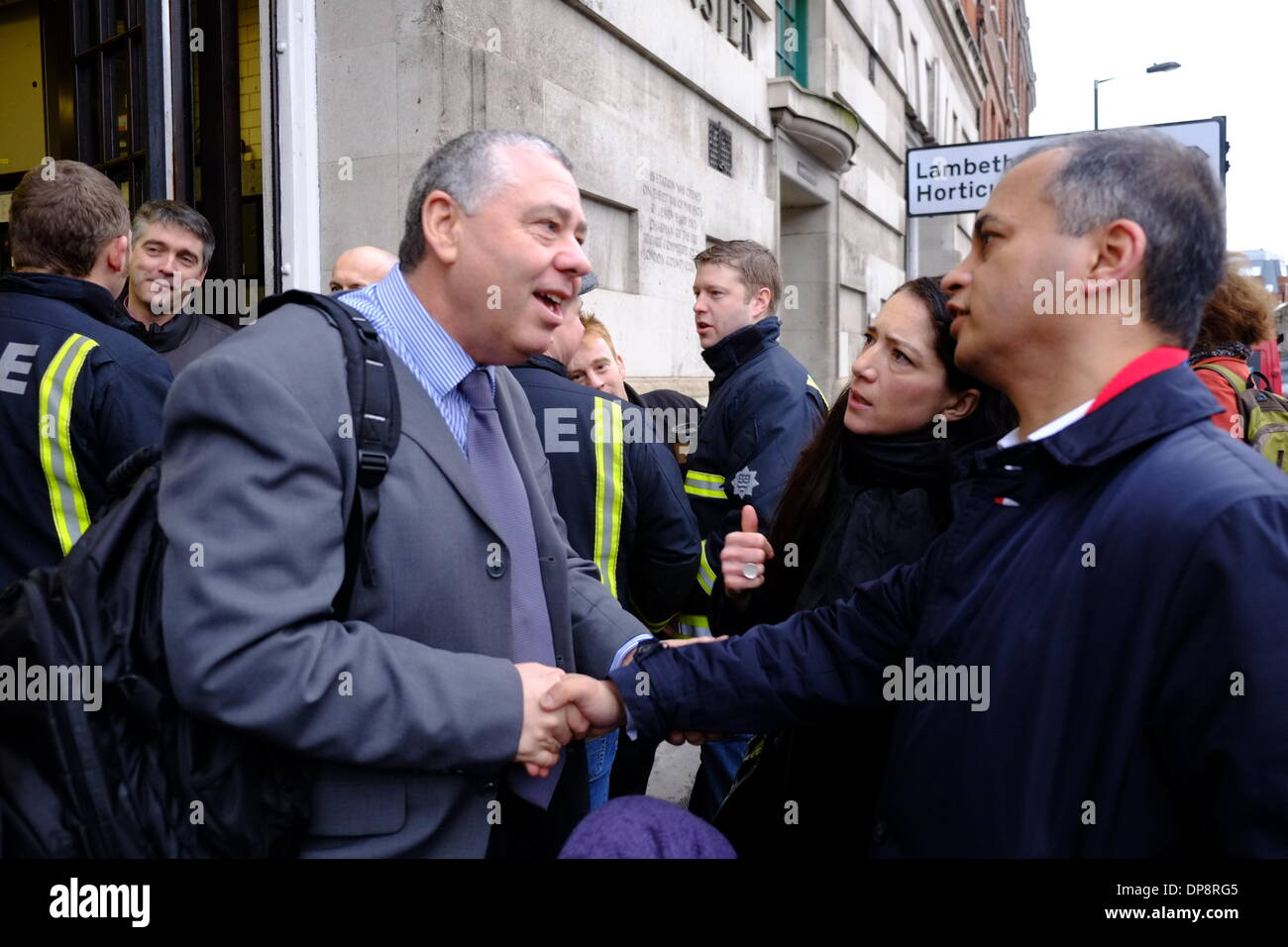 London, UK. 09th Jan, 2014. Archie Chandler shakes hands with Muad Qureshi from London Assembly as Fire Brigade staff and supporters gather at Westminster Fire Station for the last time before it shut at 9.30am. Credit:  Rachel Megawhat/Alamy Live News - Stock Image