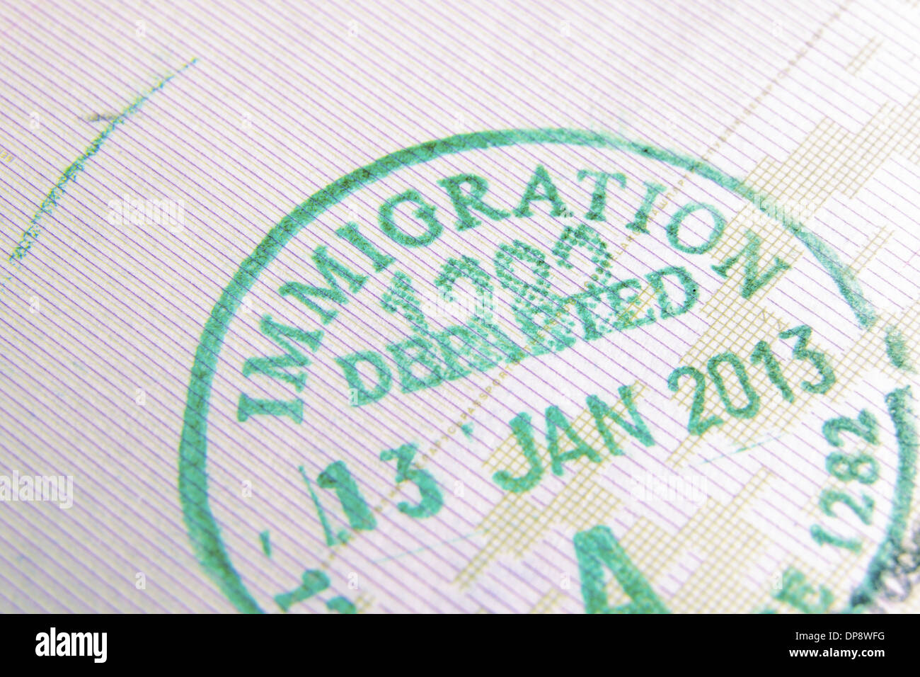 immigration control passport stamp fragment; focus on Immigration word - Stock Image