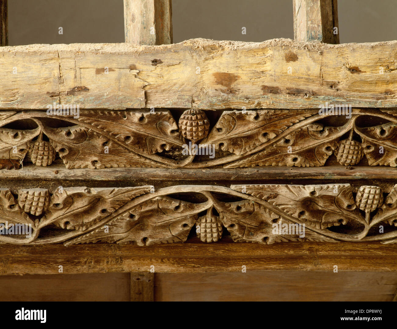 Detail of pierced vine scrolls on oak beam between the rood loft and screen (1495) in St Eilian's Church, Llaneilian, Anglesey. Christian symbolism. - Stock Image