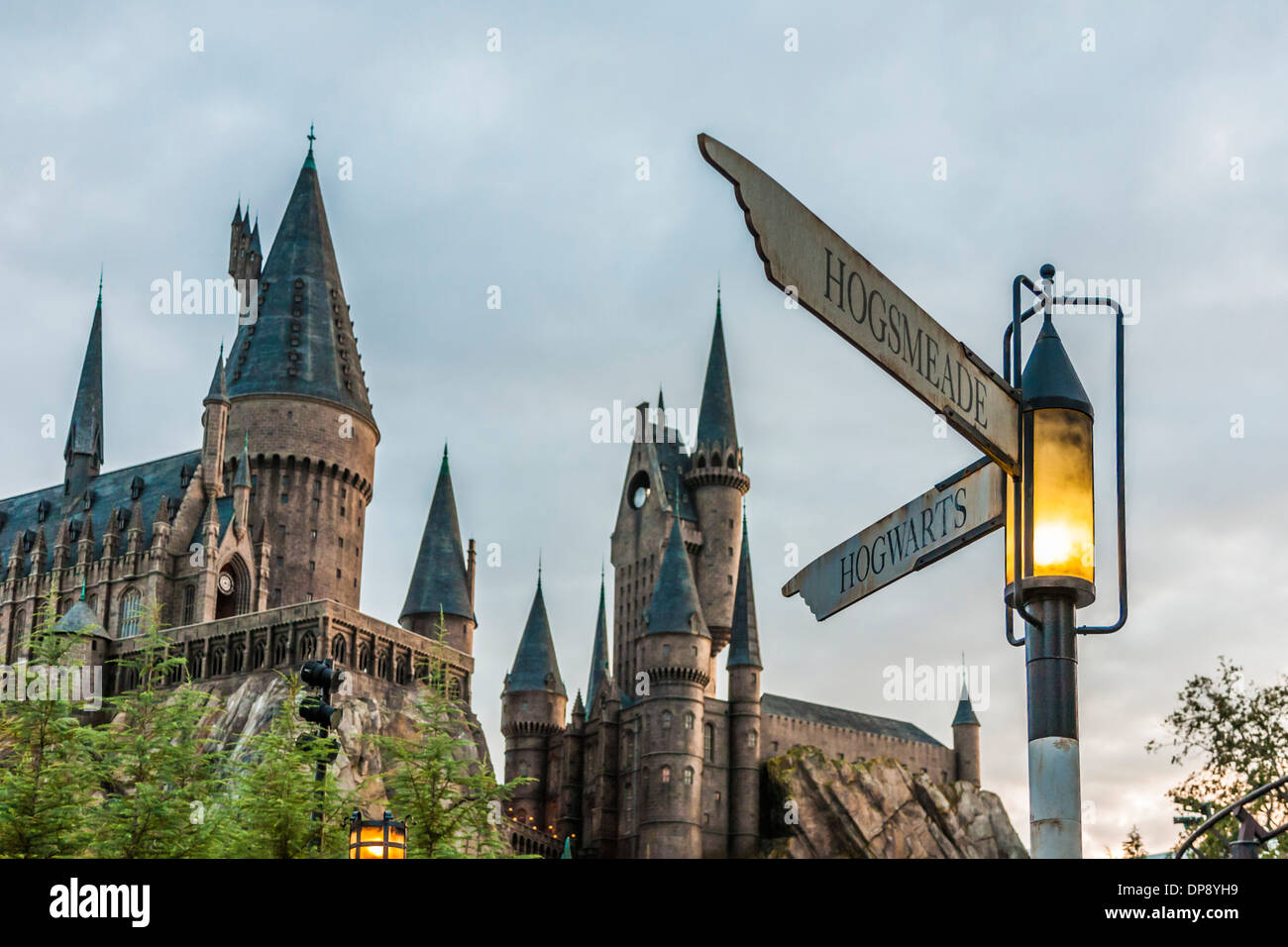 Street signs at corner of Hogsmeade and Hogwarts in front of castle in The Wizarding World of Harry Potter at Universal - Stock Image