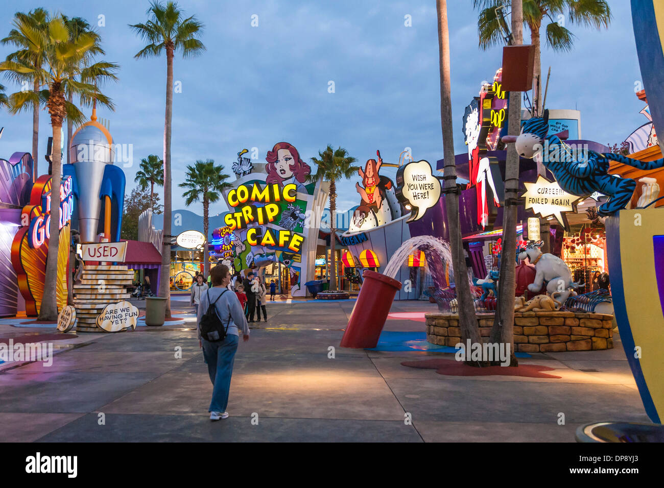 Woman walking into Toon Lagoon at Universal Studios Islands of Adventure in Orlando, Florida - Stock Image