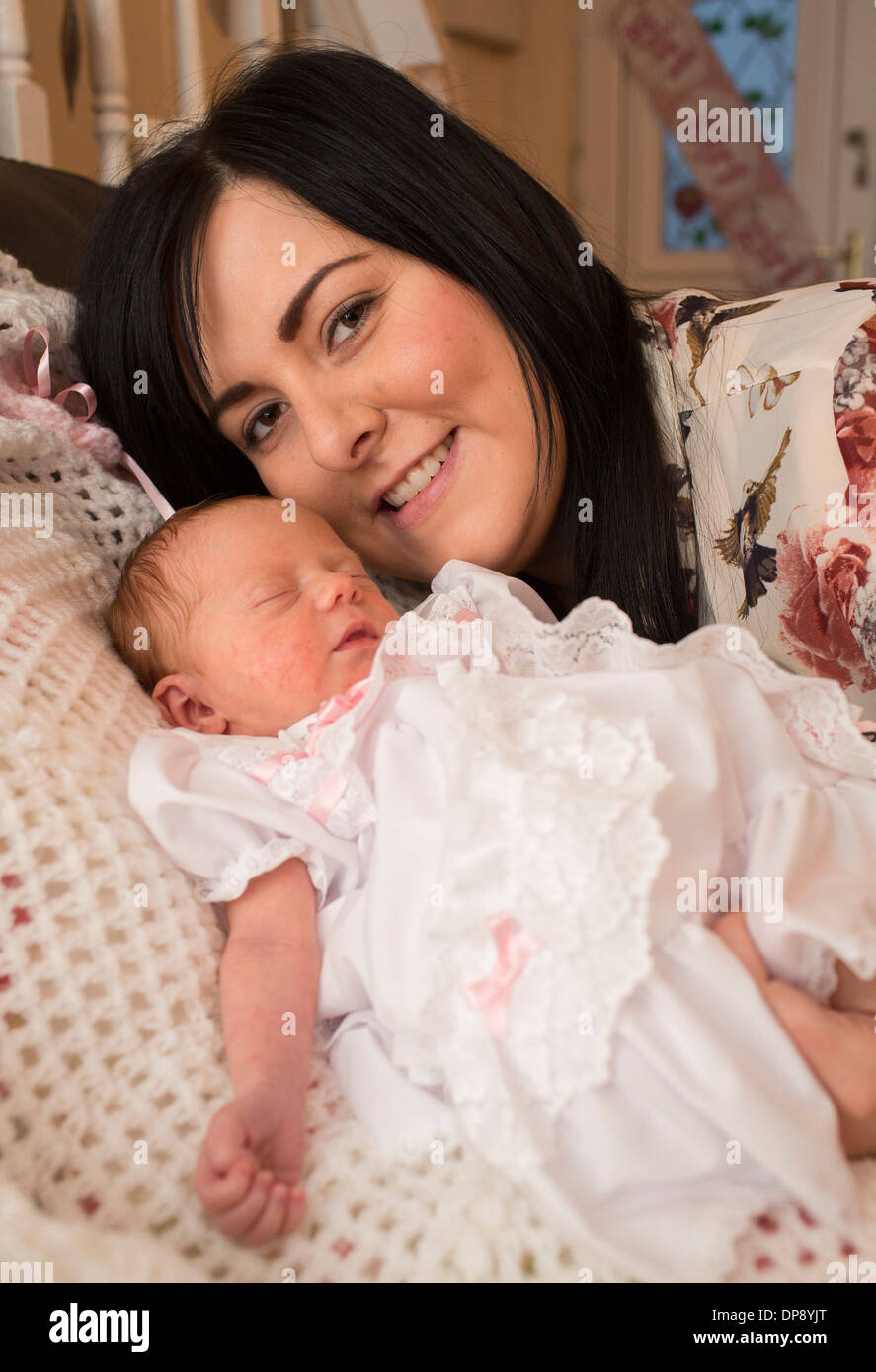 Lyndsey Foley with her daughter Poppy-Lee Foley who was born two years to the day that her brother Lee Foley was killed. - Stock Image