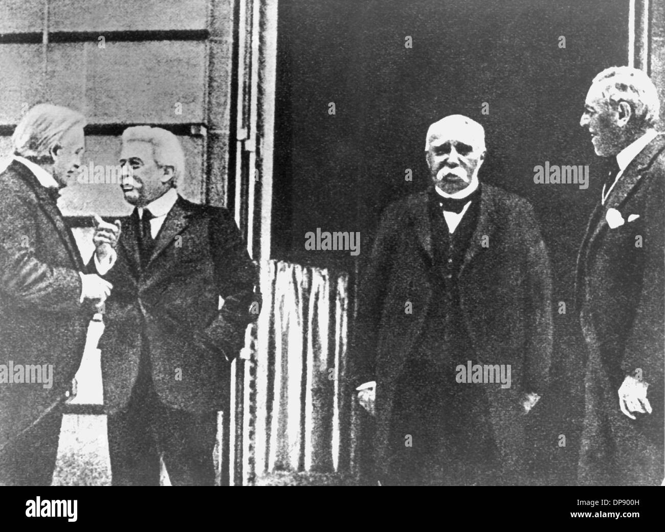 The 'Big Four' of 1919, who decided on the content of the Treaty of Versailles almost on their own (l-r): Minister presidents David Lloyd George (England), Vittorio Emanuele Orlando (Italy), Georges Benjamin Clemenceau (France) and the American president Woodrow Wilson, photographed in 1919. The Treaty of Versailles was the most important of the treaties of Paris that ended World War I in 1919/1920. The Treaty of Versailles was signed in the Palace of Versailles on the 28th of June in 1919 between Germany and 27 allied and associated powers. It became law on the 20th of January in 1920. Witho - Stock Image