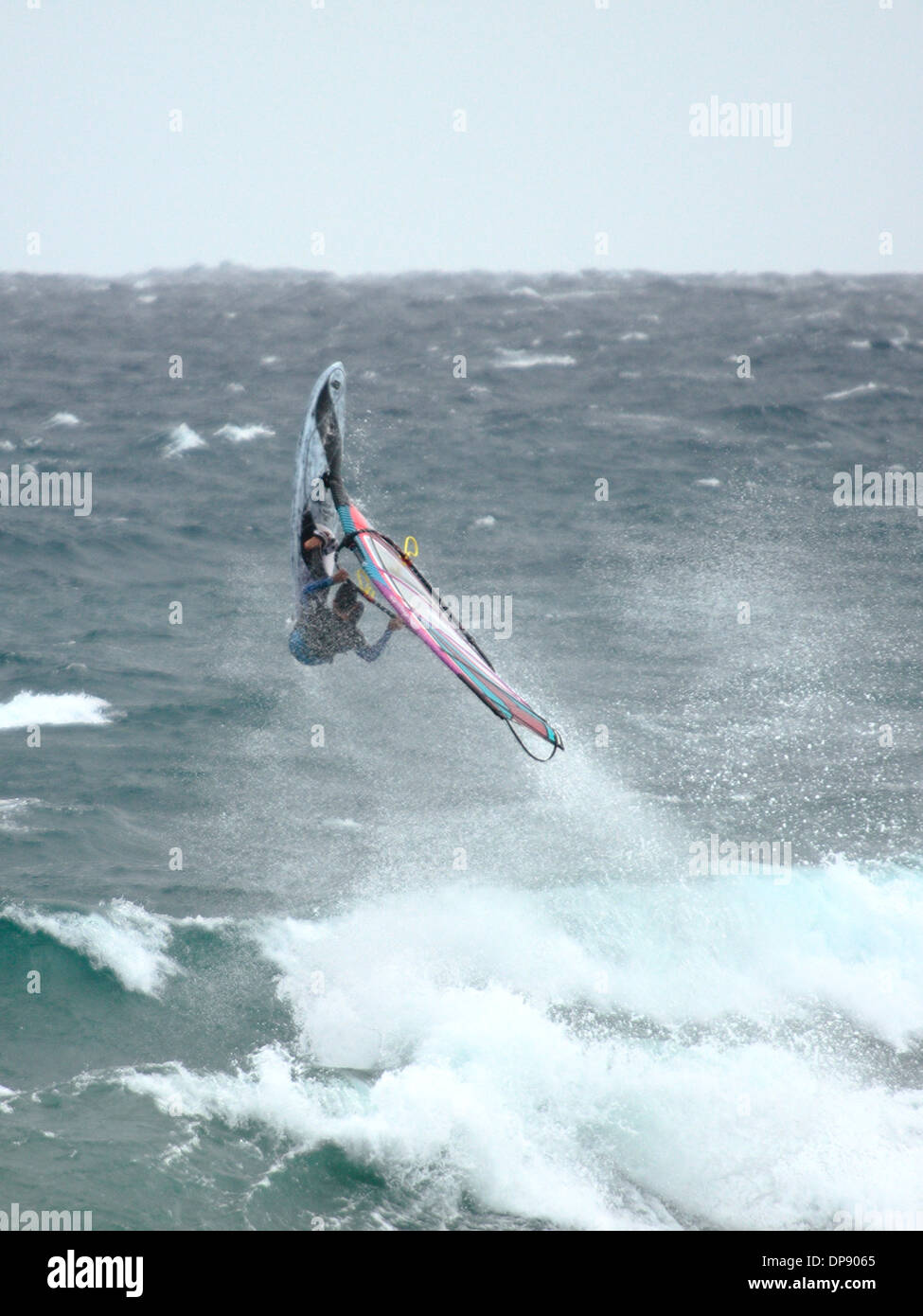 Spanish windsurfer Omar Sanchez, performing an aerial manoeuvre. - Stock Image