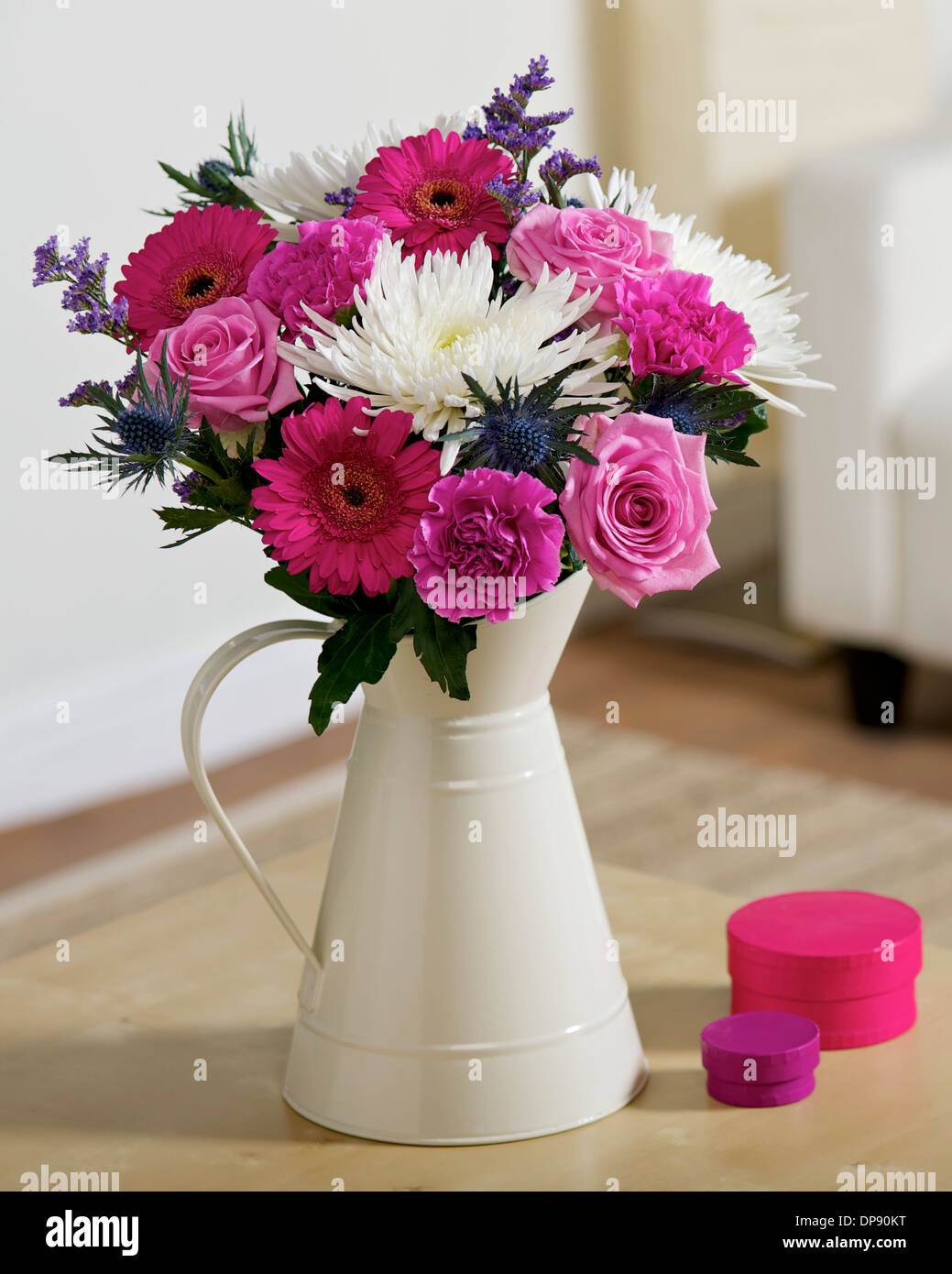 Bouquet Of Pink And White Flowers In A Cream Vase Or Jug In A Room