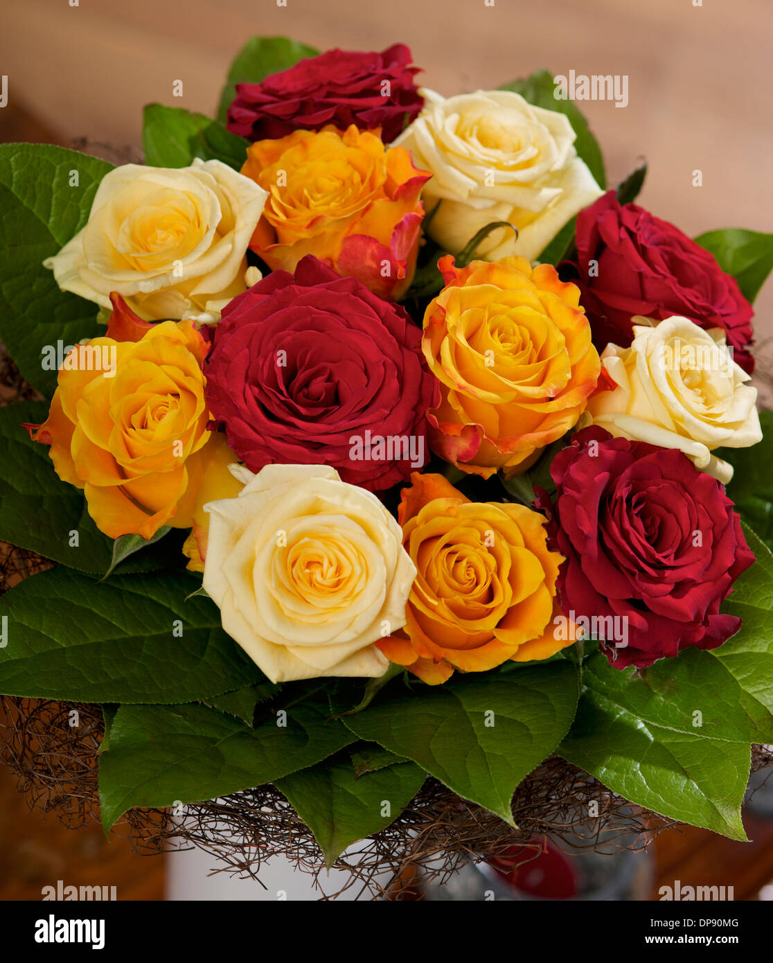 Bouquet of Cream Red and Orange Roses in vase on a table in home ...