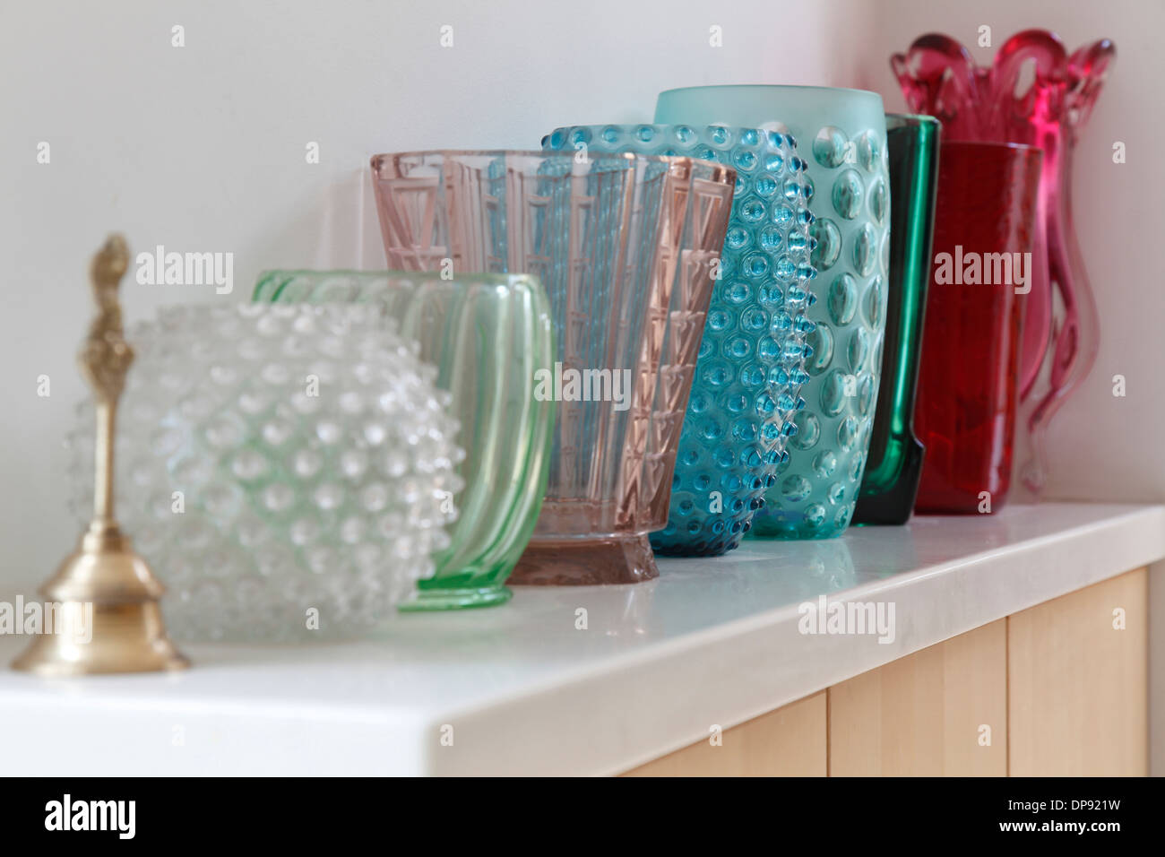 Decorative glassware in various colours Bowling Hall home interior, London, UK. - Stock Image