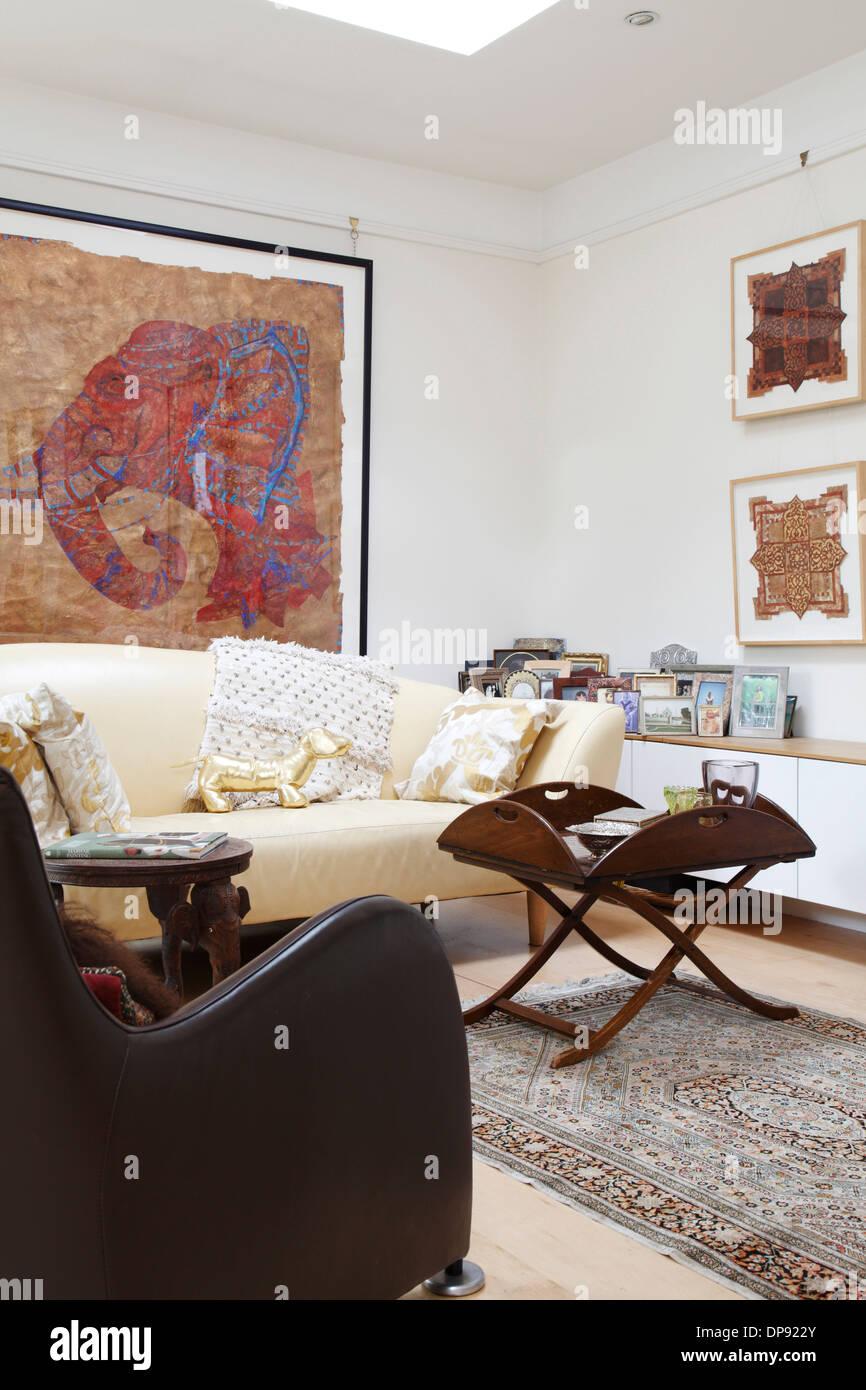 Corner of living room with large framed artwork of elephant\'s head ...
